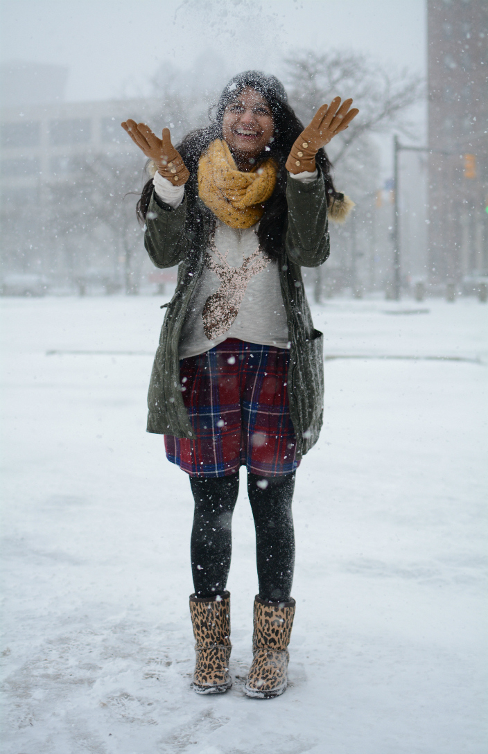 snow-parka-levis-UO-dl |Utility Jackets by popular Maryland modest fashion blog, Dreaming Loud: image of a woman wearing a utility parka with a knit mustard yellow infinity scarf, plaid leggings, leopard print boots, and black over the knee socks.