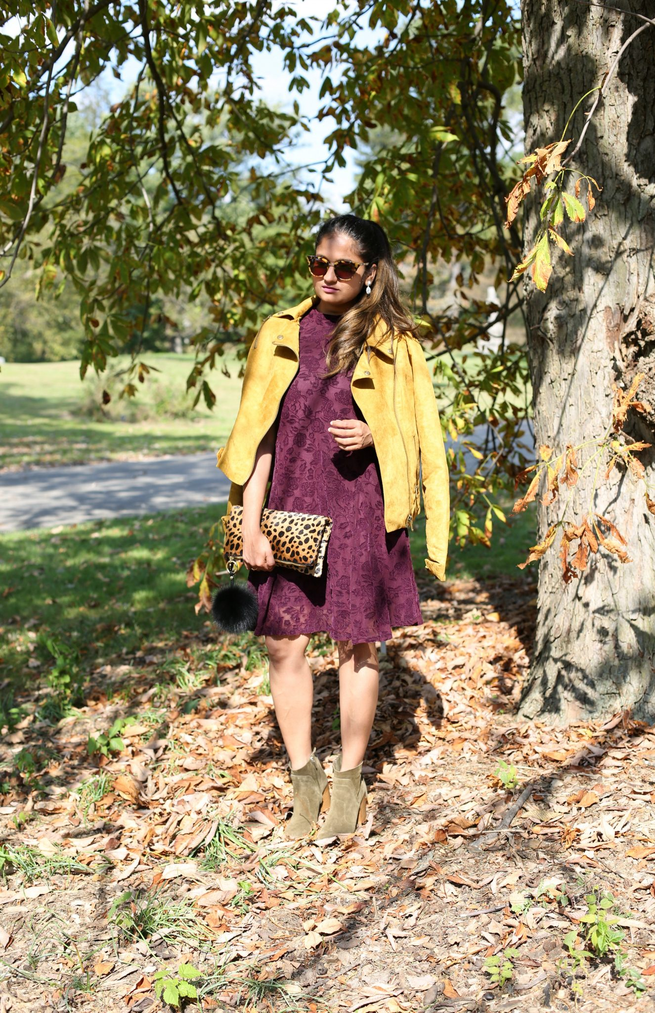 Lifestyle Blogger Surekha of Dreaming Loud Wearing Clare V Leopard Print Foldover Clutch