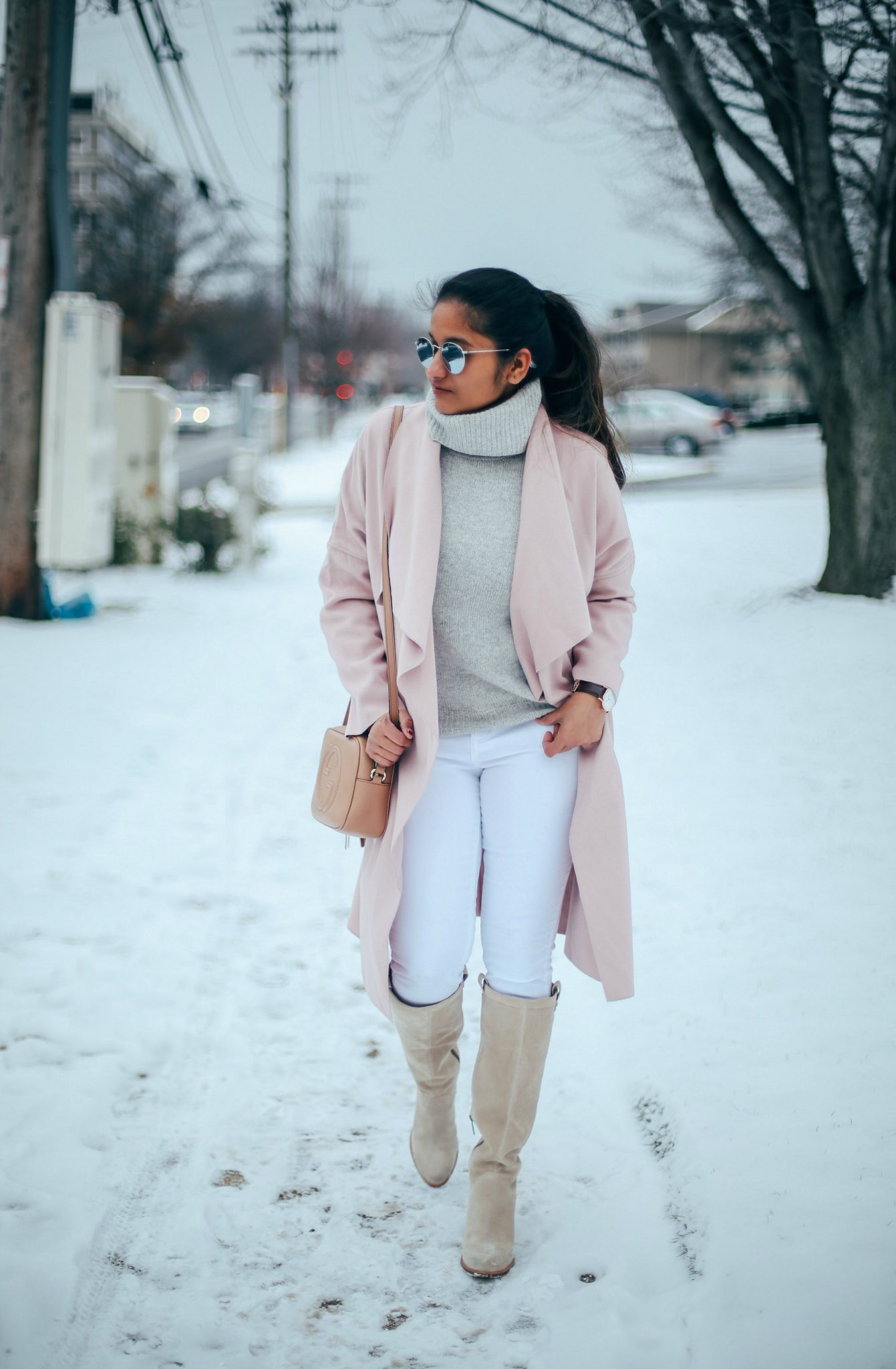10 Winter Essentials For a Cozy Look featured by top Maryland modest fashion blogger, Dreaming Loud: image of a woman wearing a pink wrap coat and white jeans