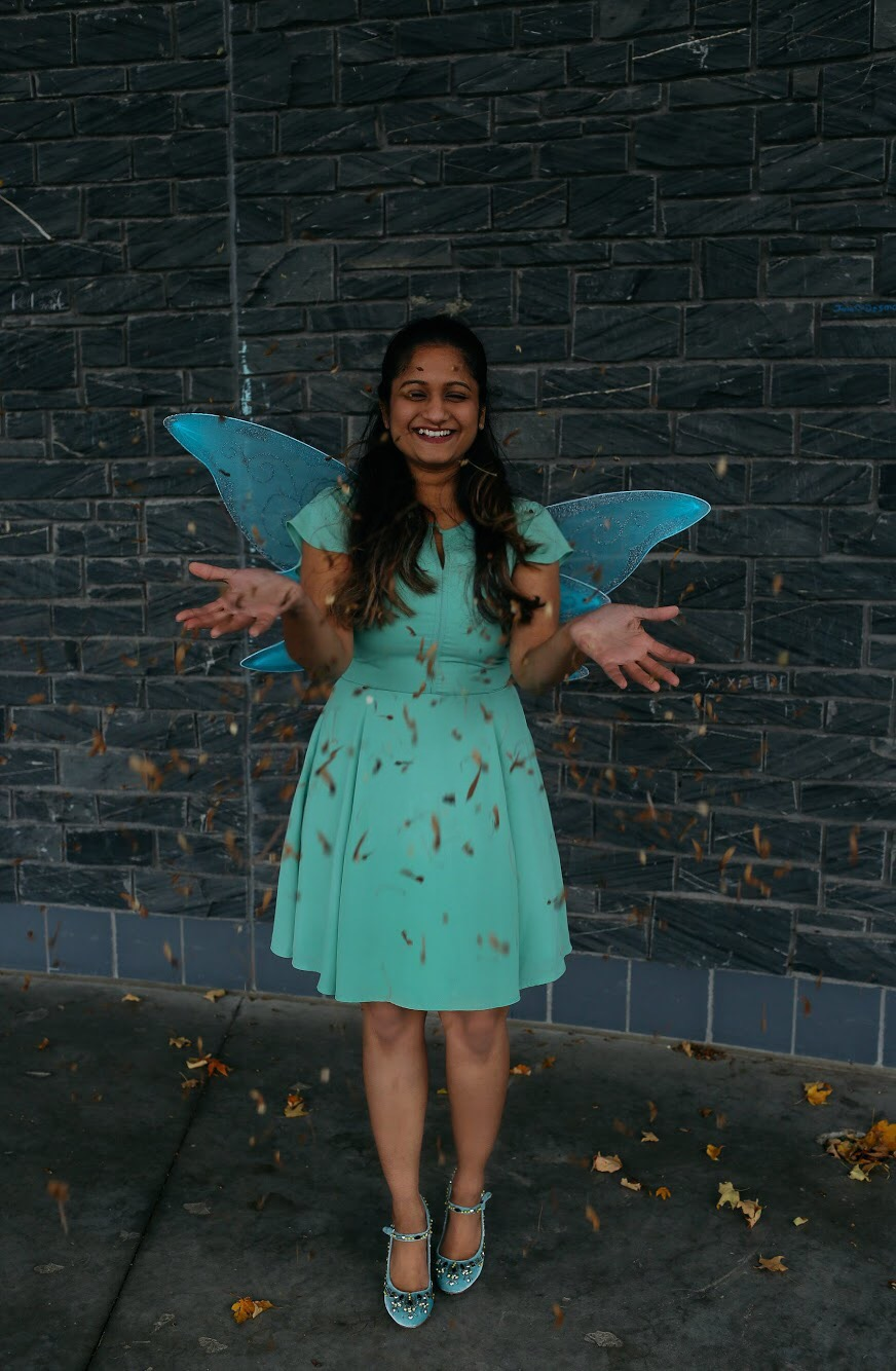 Tinkerbell Halloween Costume for Adults featured by top US modest fashion blog, Dreaming Loud: image of a woman wearing a Banana Republic dress, Fairy Wings on Amazon, and Boden heels.