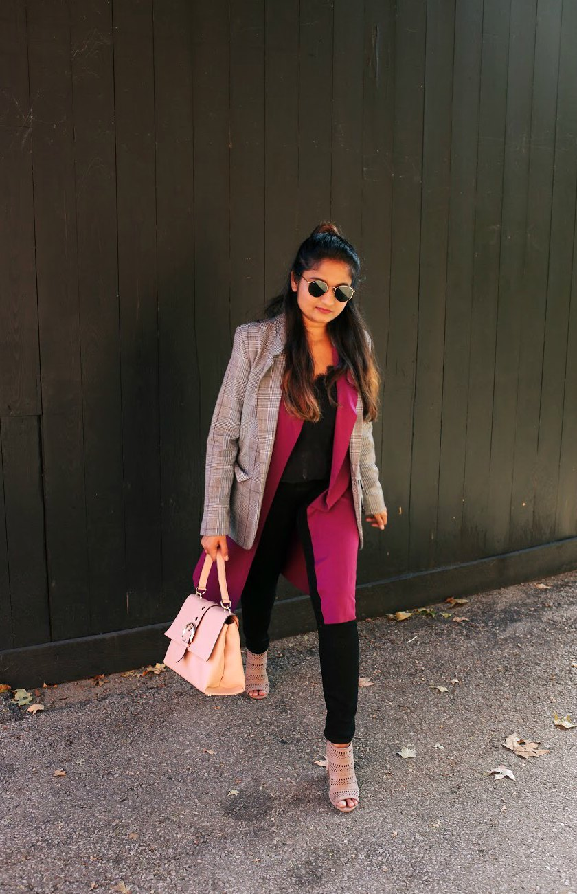 Lifestyle blogger Surekha of Dreaming Loud layering a sleeveless duster with Plaid blazer