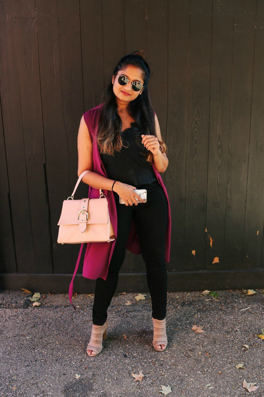 Lifestyle blogger Surekha of Dreaming Loud wearing Maddison Sleeveless Belted Duster in deep plum