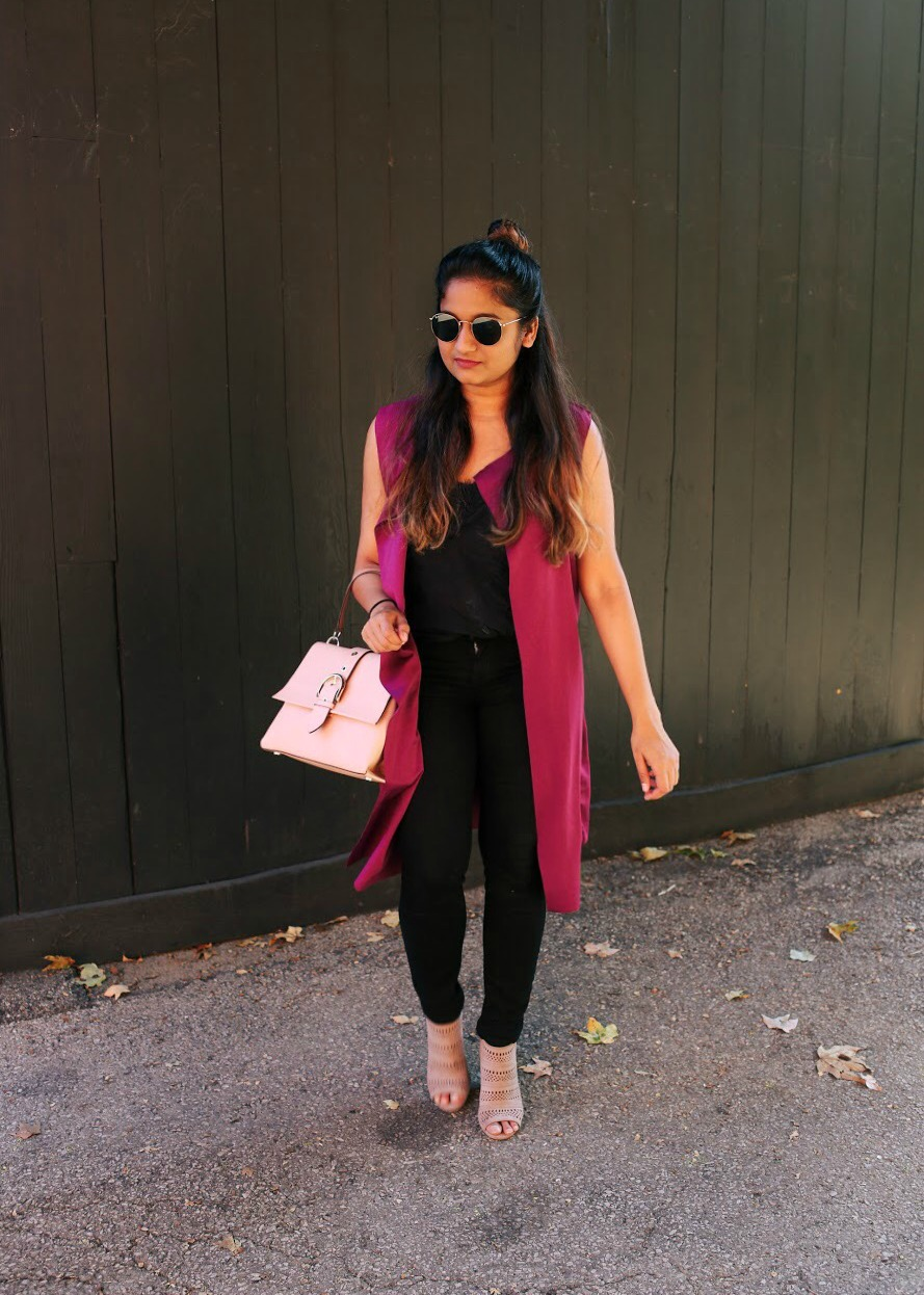 Lifestyle blogger Surekha of Dreaming Loud wearing boohoo Maddison Sleeveless Belted Duster