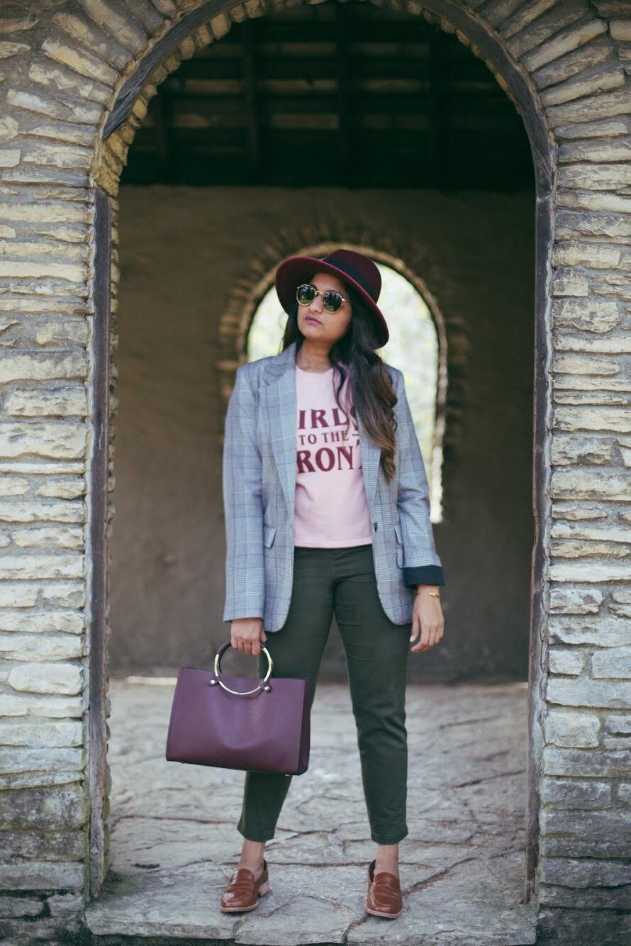 Lifestyle blogger Surekha of dreaming loud wearing Khaki chinos with plaid blazer and burgundy hat