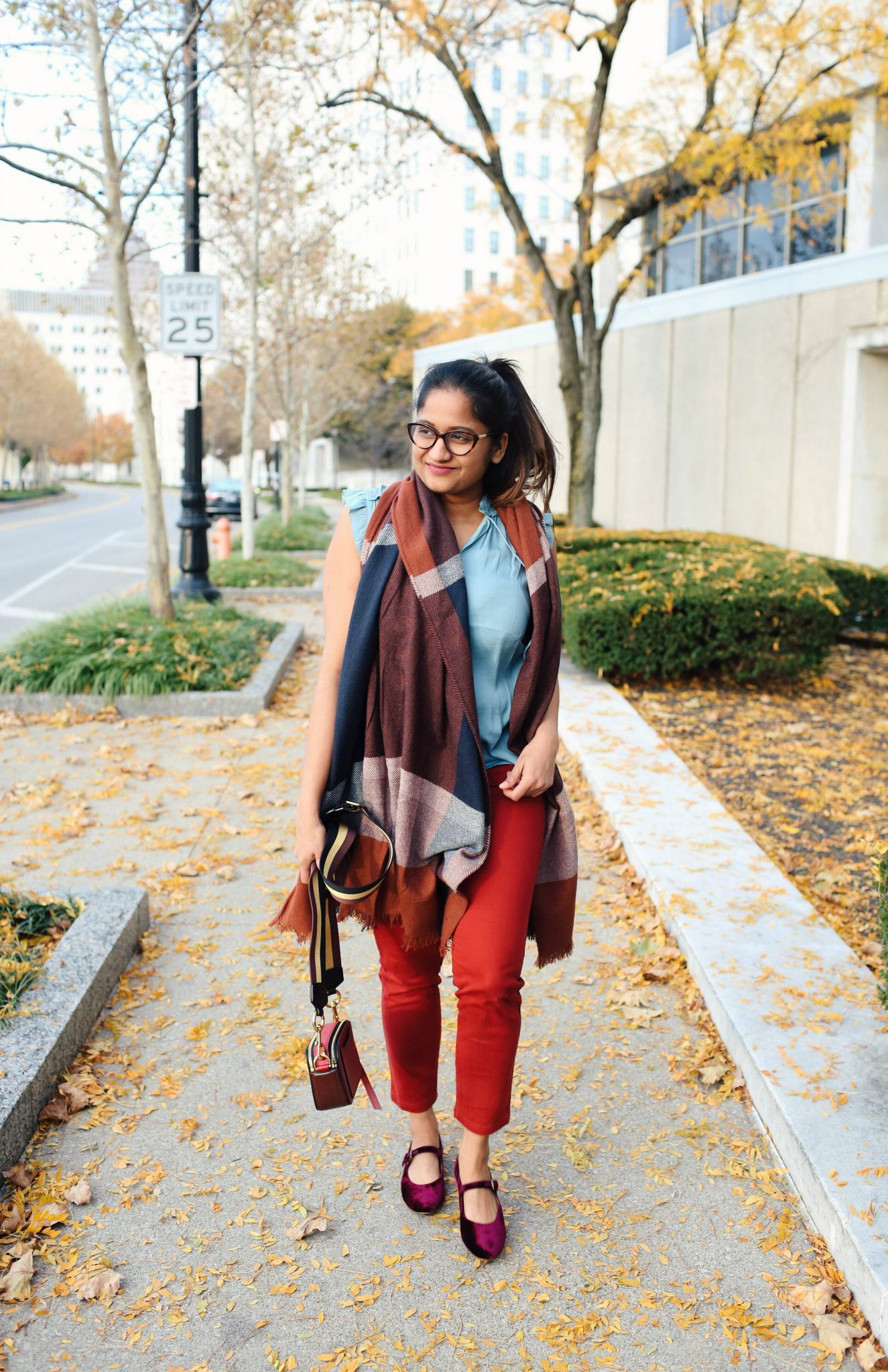 lifestyle blogger Surekha of Dreaming Loud wearing loft Smocked Ruffle Tie Neck Shell