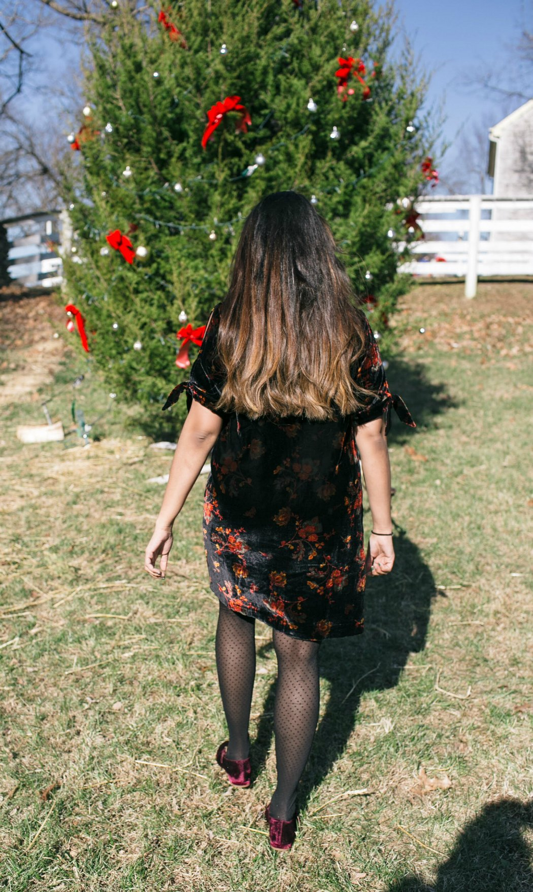 Christmas tree decorating | Holiday Velvet Floral Dress featured by top Ohio modest fashion blog Dreaming Loud