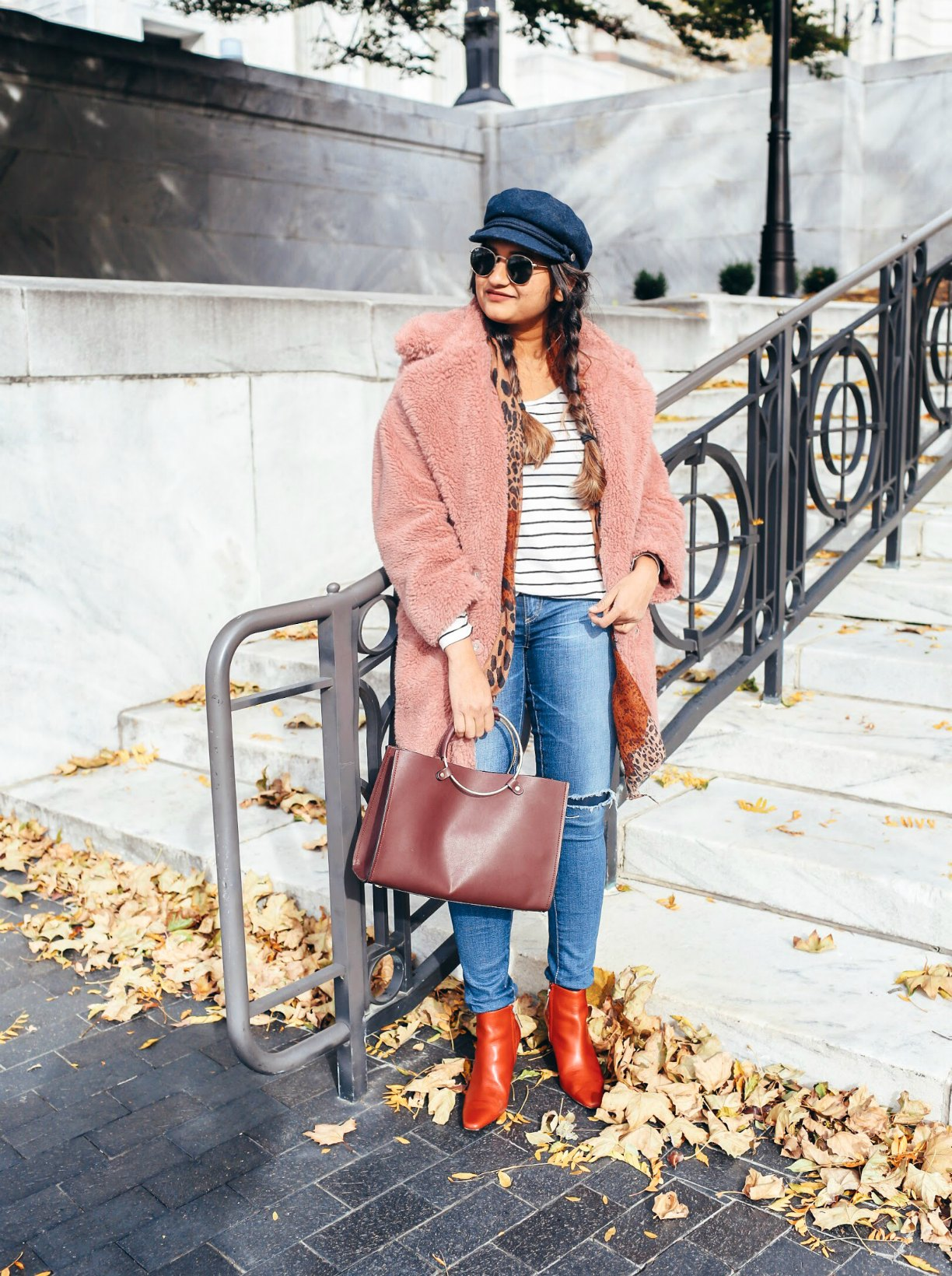 Lifestyle Blogger Surekha of dreaming loud wearing toyshop faux fur coat with boater hat and red booties - Top Winter Coat Trends featured by popular Ohio modest fashion blogger, Dreaming Loud