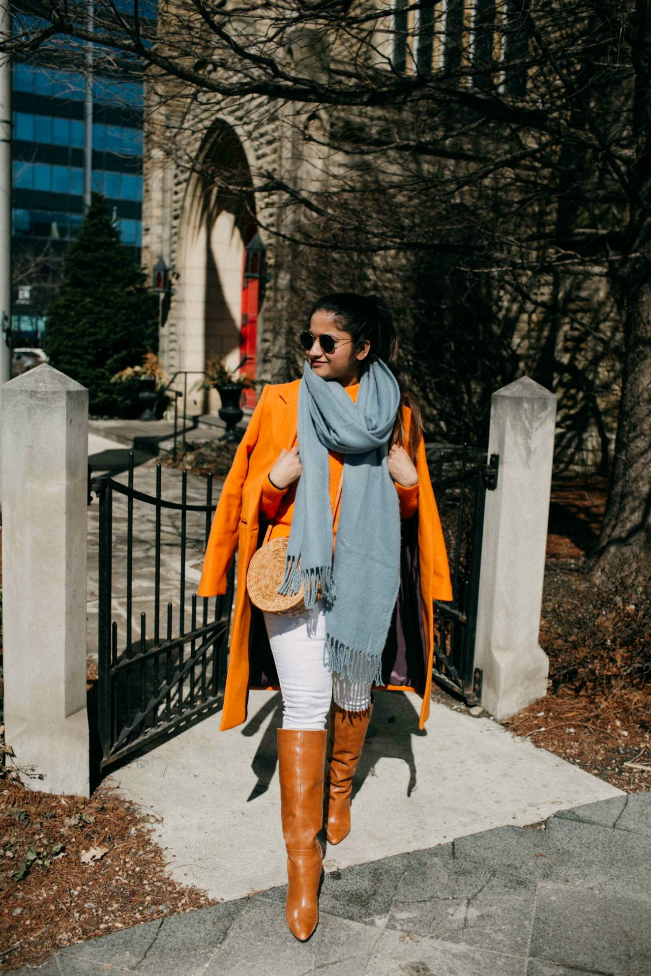 Green beauty and Fashion blogger Suri of dreaming loud sharing how to wear Orange wool coat| Blue and Orange outfit inspiration featured by popular Ohio modest fashion blogger, Dreaming Loud