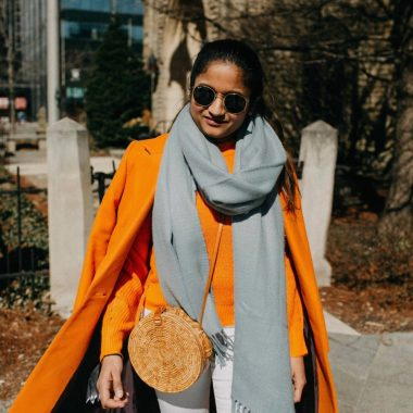 Green beauty and Fashion blogger Suri of dreaming loud wearing straw or wicker circle beach bag | Blue and Orange outfit inspiration featured by popular Ohio modest fashion blogger, Dreaming Loud
