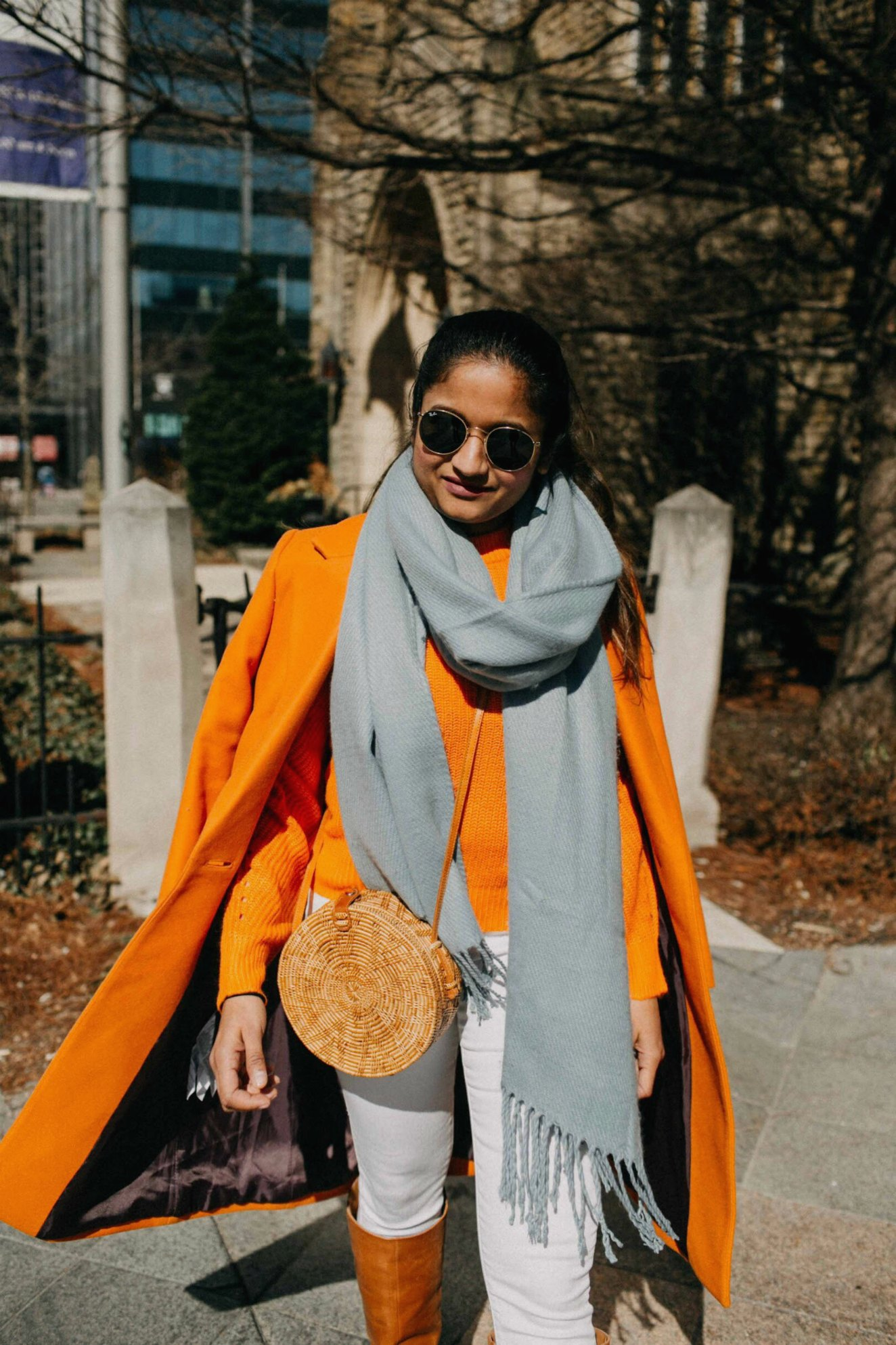 Green beauty and Fashion blogger Suri of dreaming loud wearing straw or wicker circle beach bag| Blue and Orange outfit inspiration featured by popular Ohio modest fashion blogger, Dreaming Loud