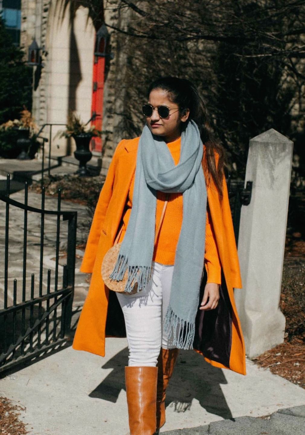 Green beauty and Fashion blogger Suri of dreaming loud wearing topshop super soft tassel scarf in light blue | Blue and Orange outfit inspiration featured by popular Ohio modest fashion blogger, Dreaming Loud