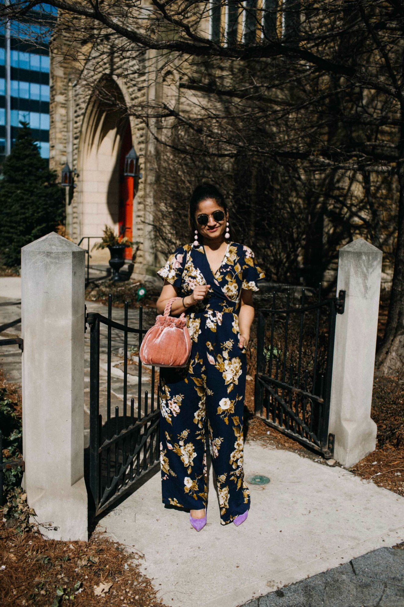 Lifestyle blogger Suri of dreaming loud wearing target Xhilaration Floral Printed Short Sleeve Jumpsuit sharing spring chic outfit ideas - Spring Outfit Ideas featured by popular Ohio modest fashion blogger, Dreaming Loud