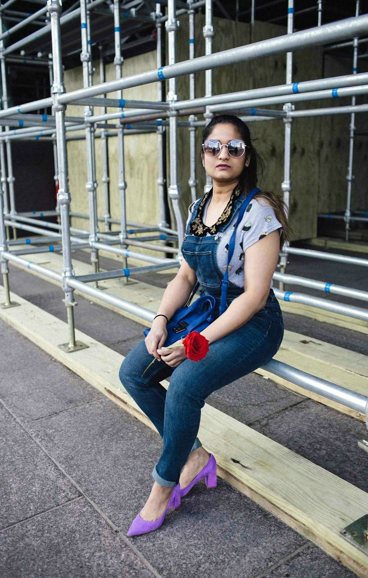 Lifestyle blogger suri of dreaming loud sharing how to wear overalls in a quirky and colorful way | H&M Overalls outfit featured by popular Ohio modest fashion blogger, Dreaming Loud