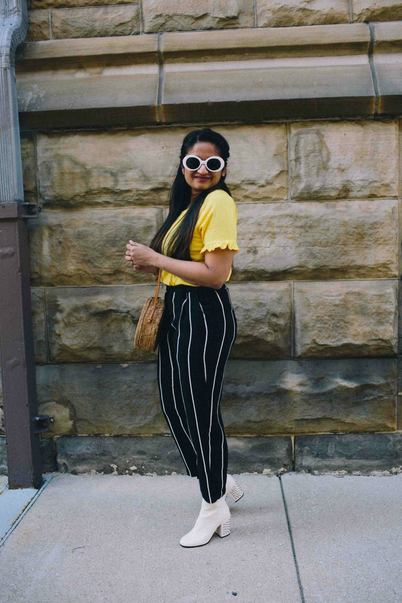 Modest Fashion and Lifestyle blogger dreaming loud wearing Dolce Vita Olin booties in white