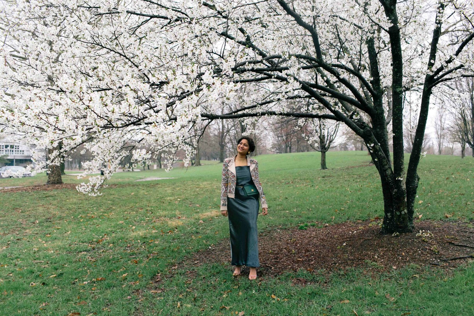 Modest fashion and lifestyle blog dreaming loud wearing banana republic Textured Satin Bias-Cut Maxi Slip Dress and standing under cherry blossom tree spring 2018 - How to Start a blog by popular Ohio blogger, Dreaming Loud