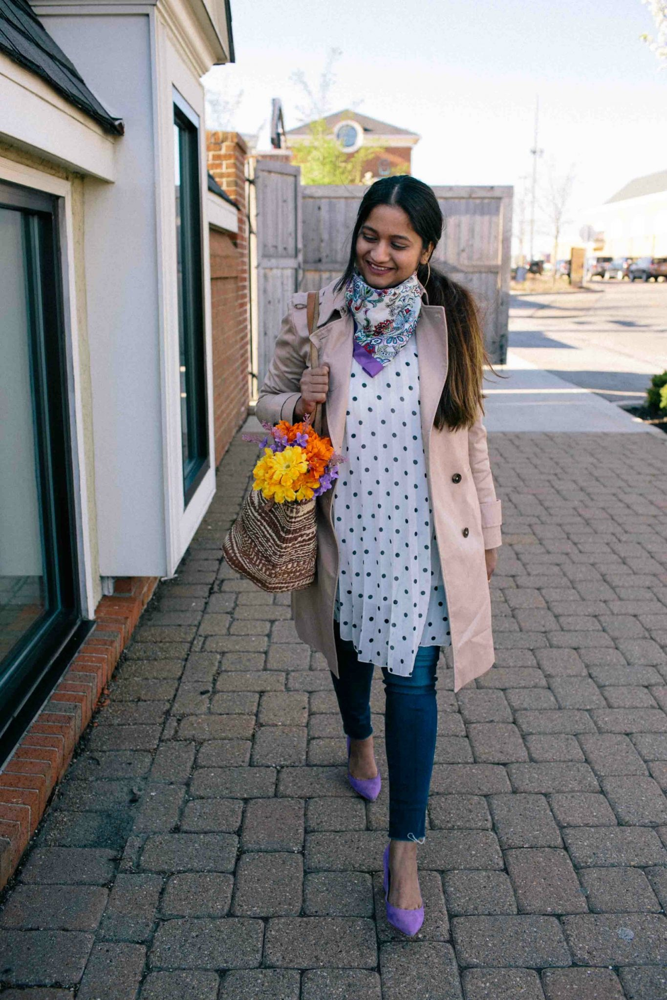 Brooks brothers Cotton Twill Trench Coat -Must Have Spring & Summer Lightweight Jackets featured by popular Ohio modest fashion blogger, Dreaming Loud | Lightweight Jackets by popular Maryland modest fashion blog, Dreaming Loud: image of a woman wearing a tan cotton twill jacket, black and white polka dot top, jeans, purple suede heels, and pink and blue paisley scarf.