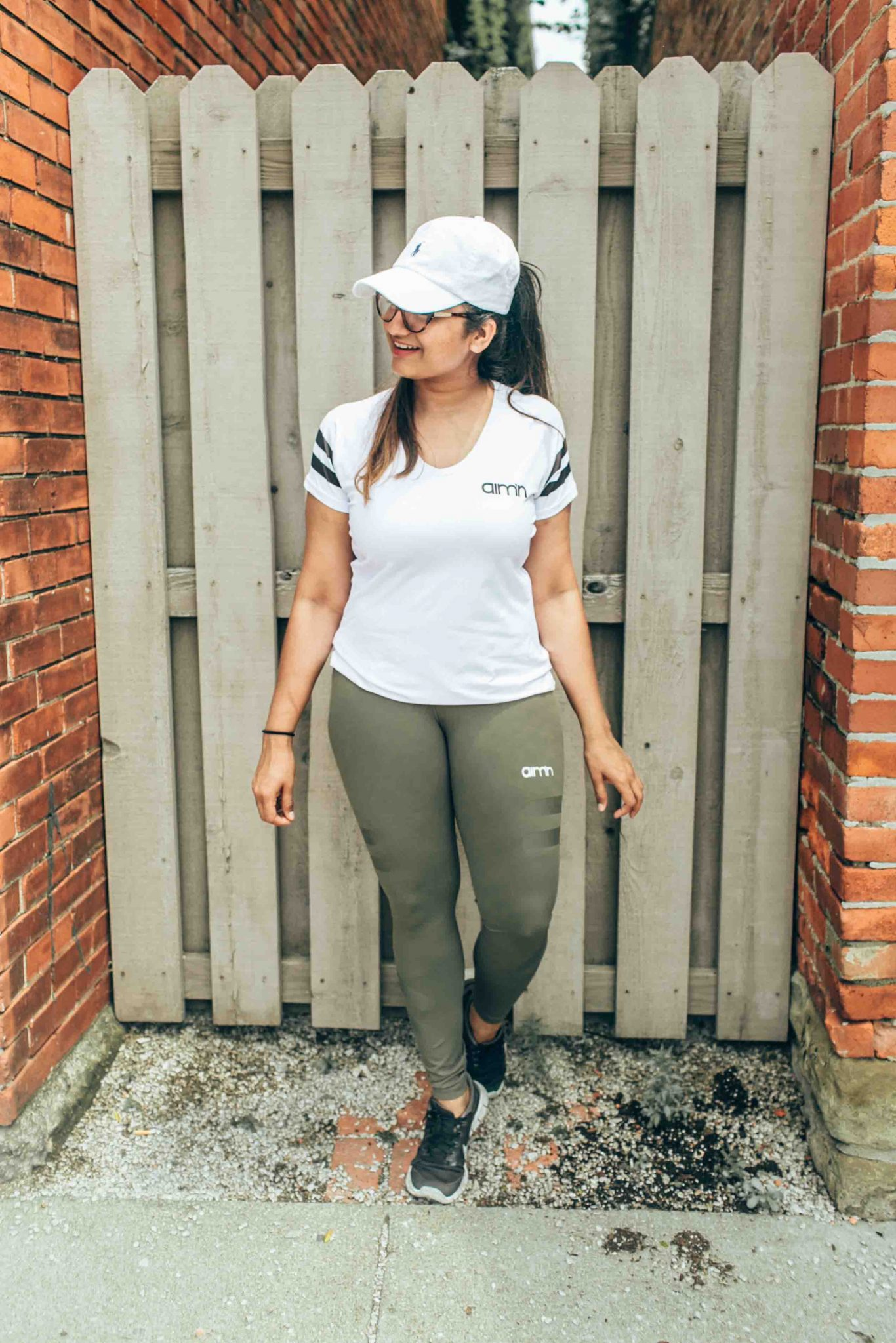 Wearing Aimn Sportswear WHITE TRIBE T-SHIRT - Aim'n Sportswear 20% off coupon featured by popular Ohio modest fashion blogger, Dreaming Loud