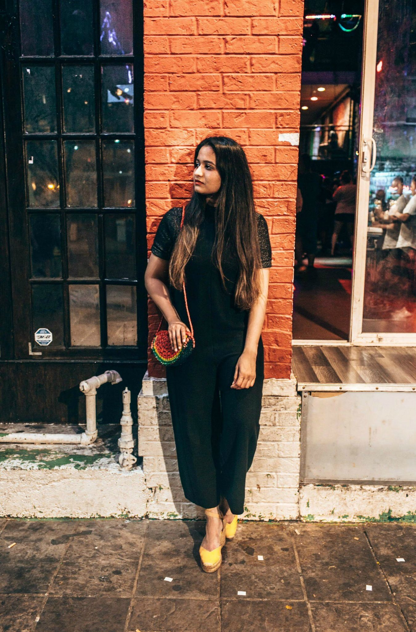 wearing Madewell Texture & Thread Side-Tie Jumpsuit in black q1 - A Day in Austin and San Antonio -Attractions, Where to Eat and What to Wear featured by popular Ohio travel blogger, Dreaming Loud