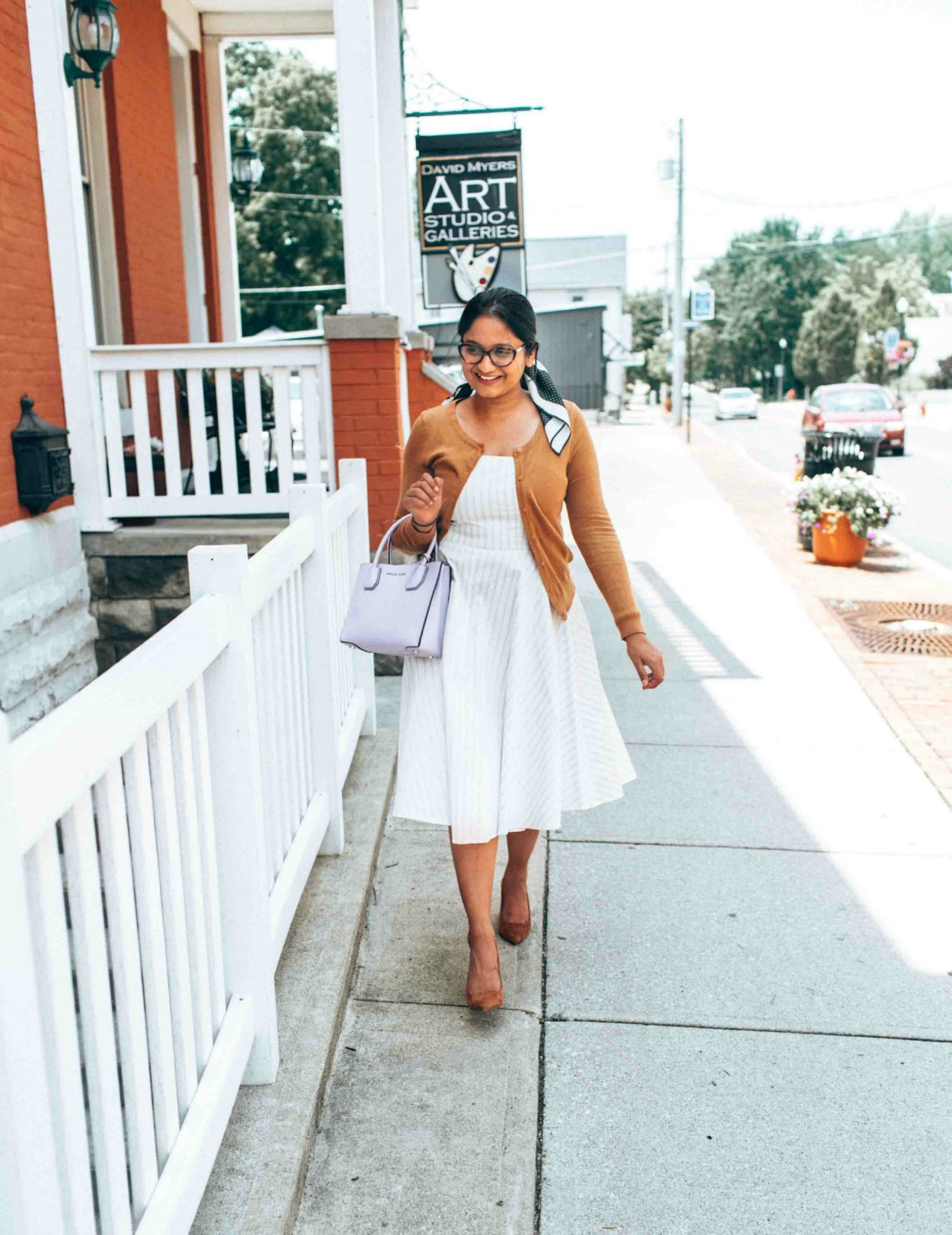wearing classy white and cognac combo - Leith White Fit & Flare Dress styled by popular US modest fashion blogger, Dreaming Loud
