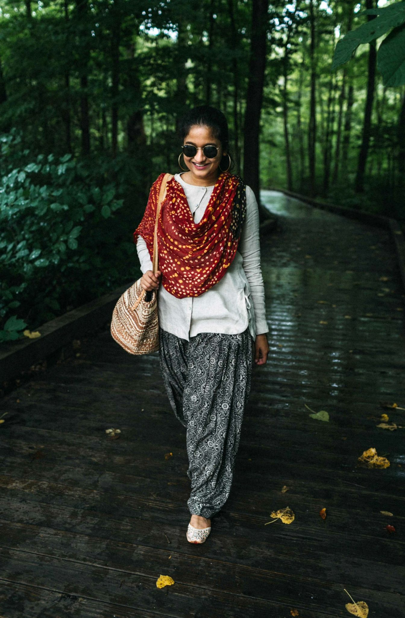 wearing J.Jill Linen Side-Tie Tunic with Patiala pant | 15 Desi / Indian Customs of Mine: wearing patiala pants, featured by popular Ohio fashion blogger, Dreaming Loud | Indo Western by popular Maryland modest fashion blog, Dreaming Loud: image of a woman wearing an Indo Wester outfit with a linen top, red print dupatta, and patiala pants.