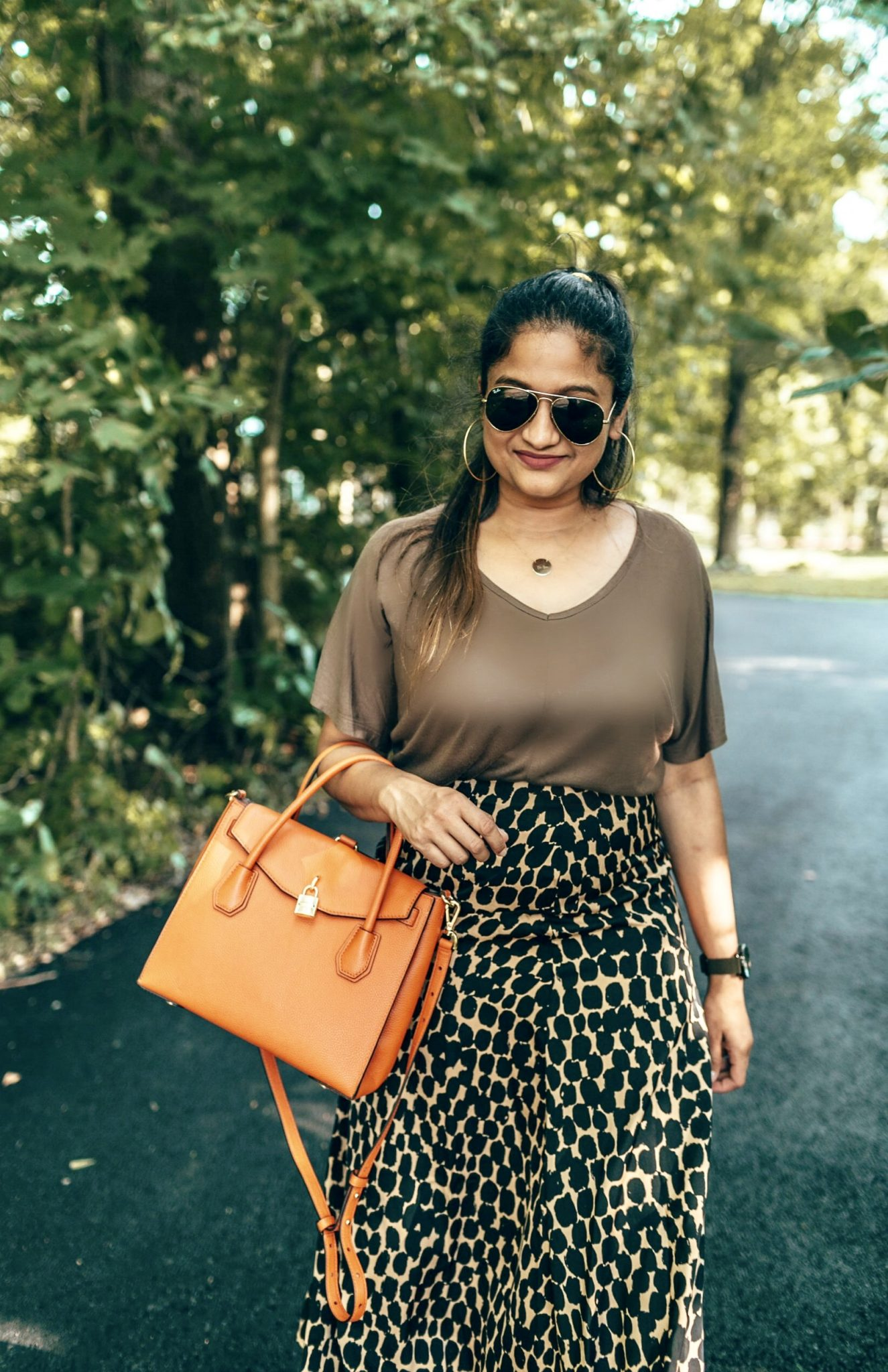 wearing Michael Michael Kors Studio Mercer Orange Leather Large All In One Bag in orange | The Leopard Print Trend featured by popular US modest fashion blogger, Dreaming Loud
