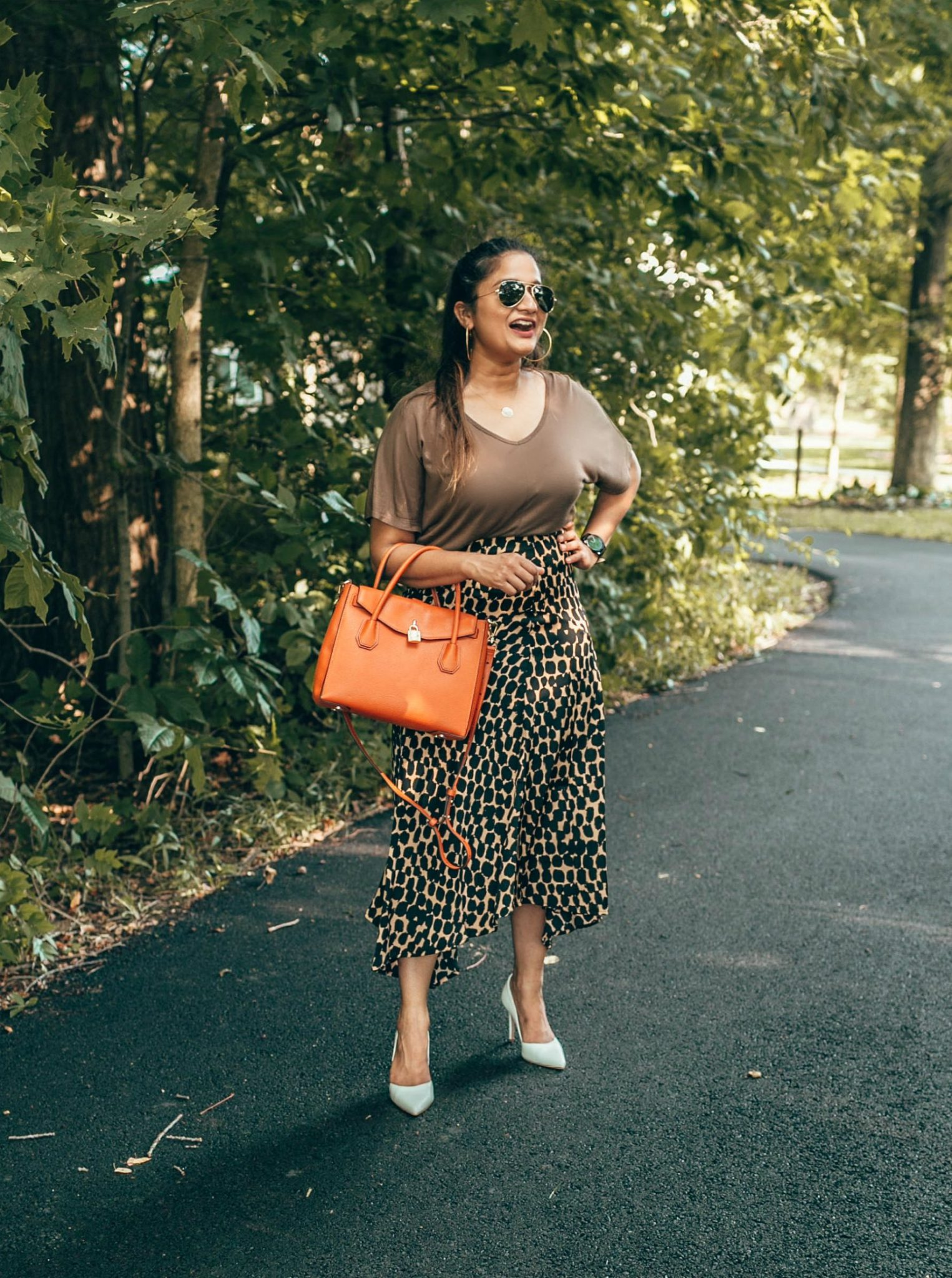 wearing VINCE CAMUTO AIRMOSAH PUMP in white | The Leopard Print Trend featured by popular Ohio modest fashion blogger, Dreaming Loud