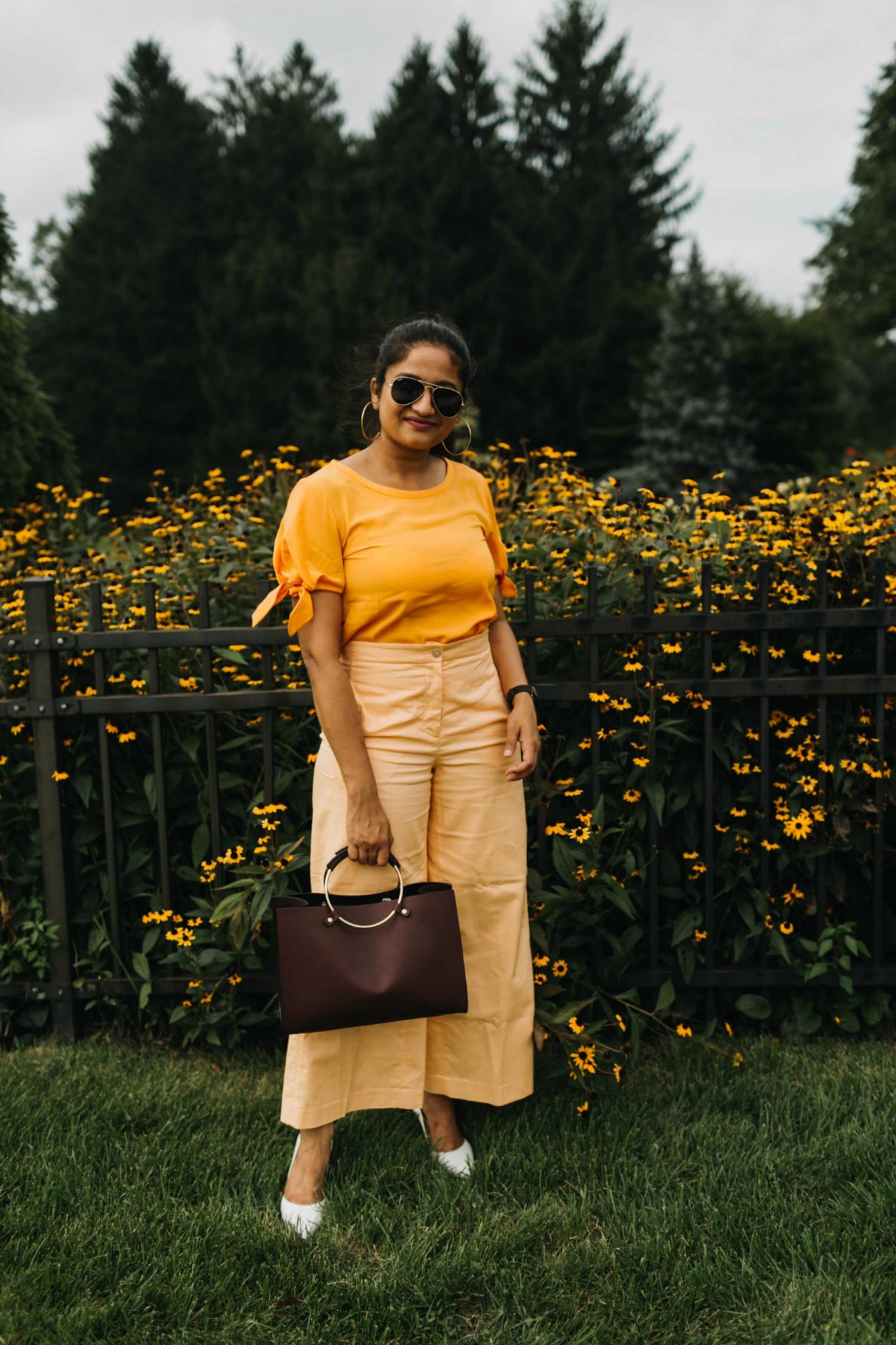 Wearing Burgundy metal handle bag Rockwell Mini bag | Orange Monochrome Outfit from the Ann Taylor Sale featured by popular US modest fashion blogger, Dreaming Loud