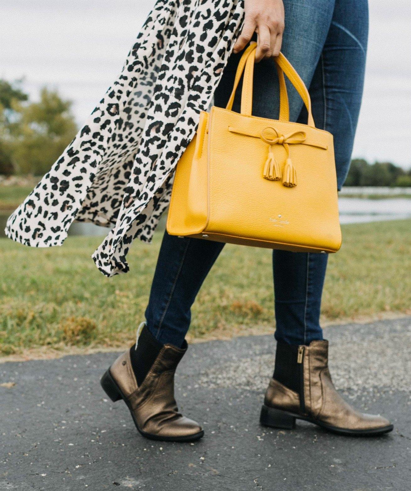 wearing MICHAEL Michael Kors Mercer Medium Messenger in marigold | Aetrex fall booties featured by top US fashion blog, Dreaming Loud