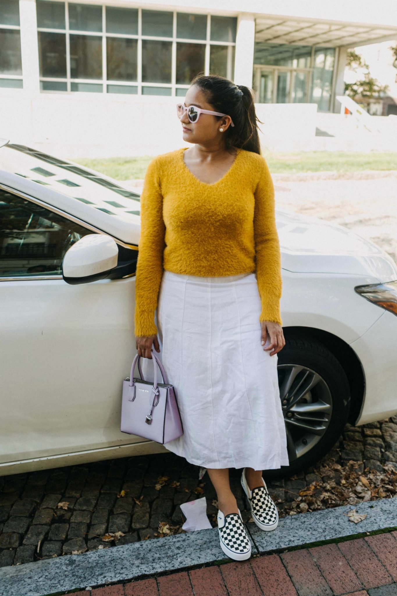 Wearing Boden LAURIE white SKIRT and Marks and Spenser Faux Fur Yarn V-Neck Jumper| 13 Cozy and Cute Thanksgiving outfit ideas featured by top US modest fashion blog, Dreaming Loud