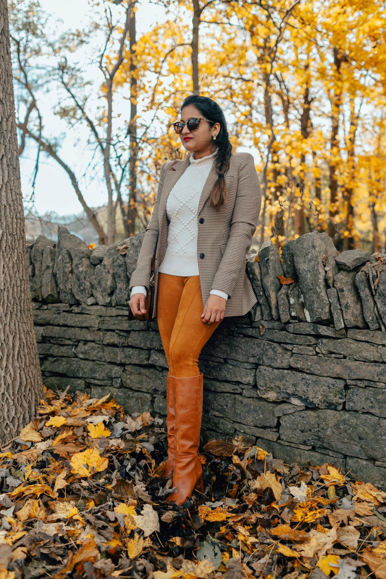wearing Nine West Women's Christie Knee High Boot | The Best Fall Boots Under $150 featured by top US fashion blog, Dreaming Loud: over the knee leather boots