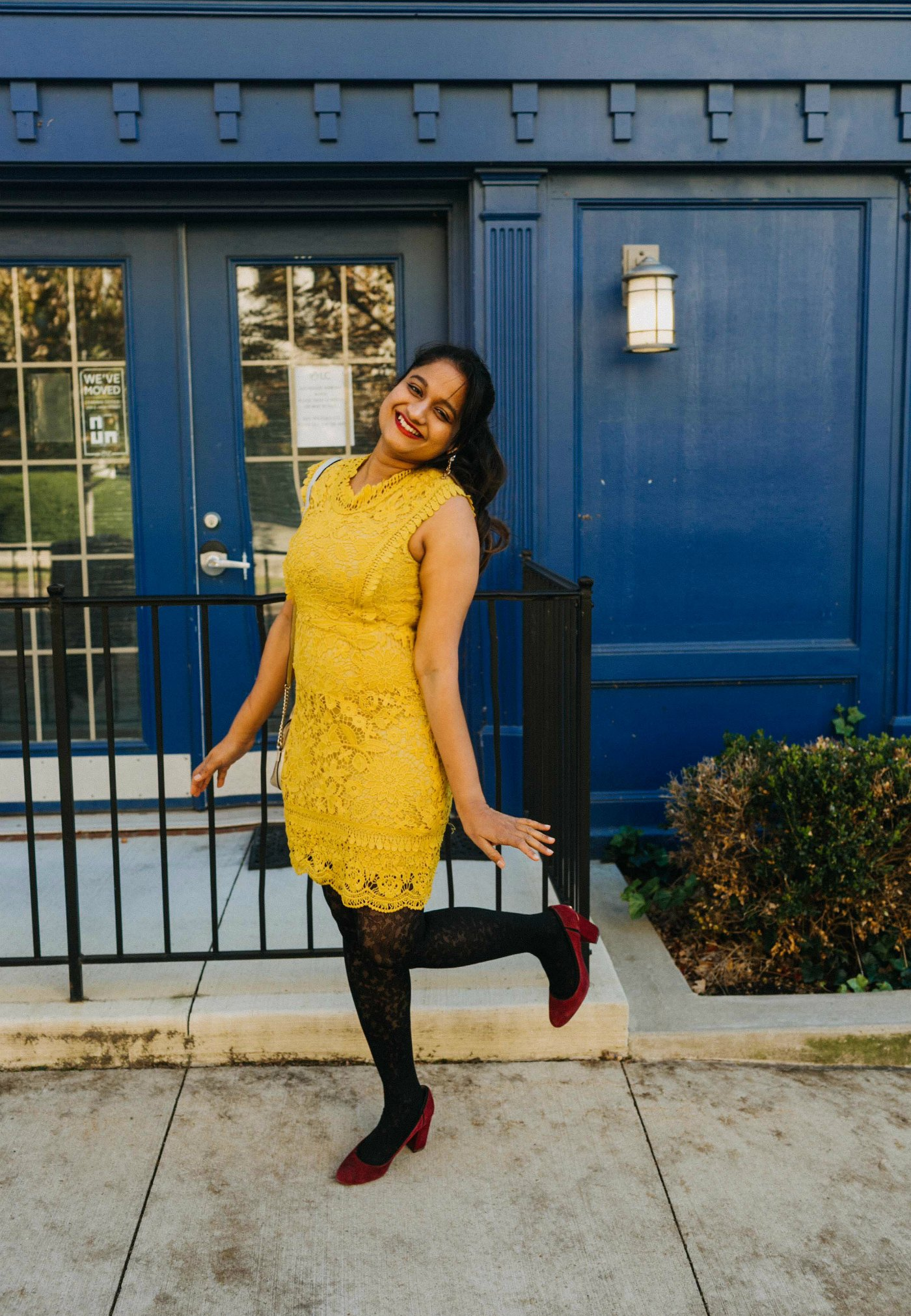 9 Cute Lace Dresses under $200 -1 | Cute Modest lace dresses featured by top US modest fashion blog, Dreaming Loud: image of a woman wearing a Vici lace dress, Gisi earrings, Tommy Hilfiger belted military coat, Ann Taylor floral tights, J.Crew factory suede pumps and a Michael Kors satchel handbag