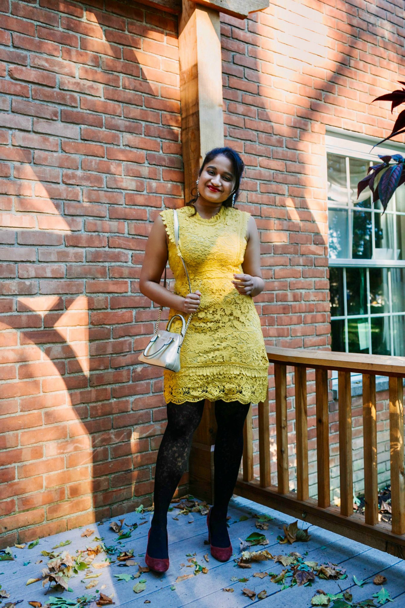 Cute Modest lace dresses featured by top US modest fashion blog, Dreaming Loud: image of a woman wearing a Vici lace dress, Gisi earrings, Tommy Hilfiger belted military coat, Ann Taylor floral tights, J.Crew factory suede pumps and a Michael Kors satchel handbag