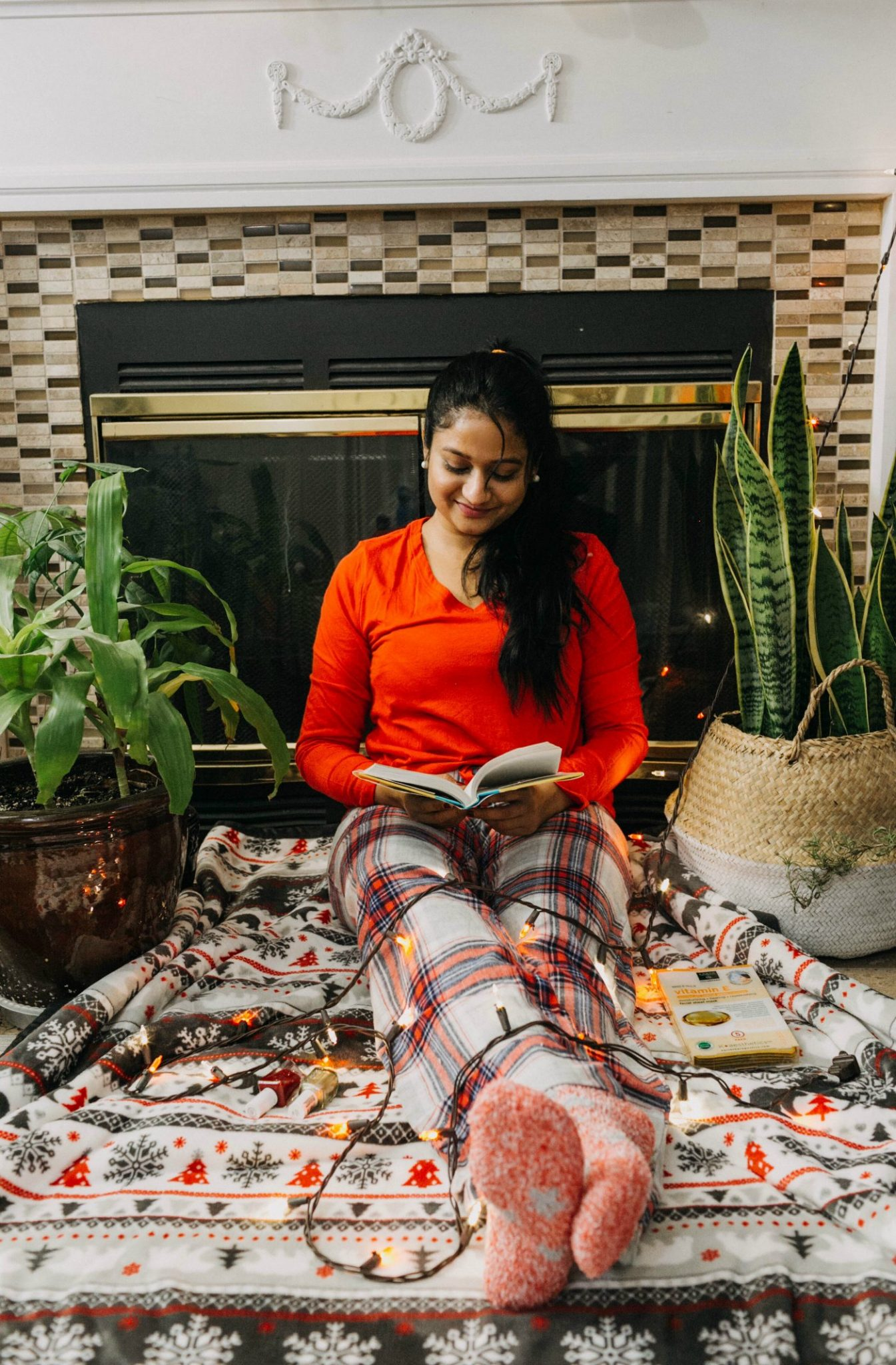 last minute holiday gift ideas for your family | | 7 Kohl's Gifts Under $25 featured by top US life and style blog, Dreaming Loud: image of a woman sitting on a Sherpa fleece throw available at Kohls
