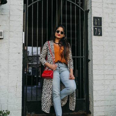 wearing Levis Wedgie Icon Fit High Waist Crop Jeans | Leopard Kimono trend featured by top Ohio modest fashion blog, Dreaming Loud: image of a woman wearing a Dynamite Leopard print Kimono, Levi's High waist jeans, Dynamite lace camisole, checkered Van's, Lulu Guiness leather bag and Madewell hoop earrings