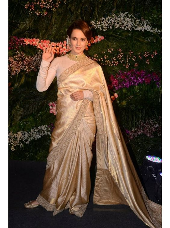 Kaganna Ranauat wearing gold Kanjeevaram saree | South Indian wedding saree trends featured by top US and Indian fashion blog, Dreaming Loud: image of a metallic silver Saree