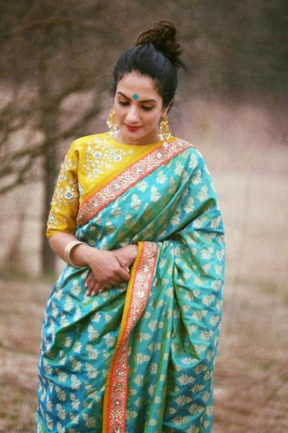 Pastel Color green and yellow Kanjeevaram saree  | South indian wedding saree trends featured by top US and Indian fashion blog, Dreaming Loud: image of a pastel Saree