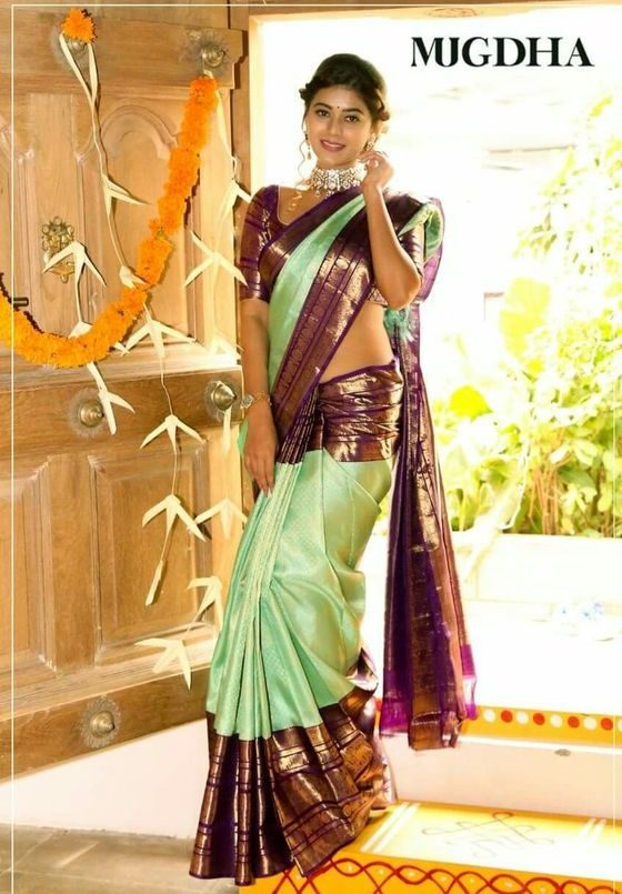 Green kanjeevaram wedding saree | South Indian wedding saree trends featured by top US and Indian fashion blog, Dreaming Loud: image of a green saree