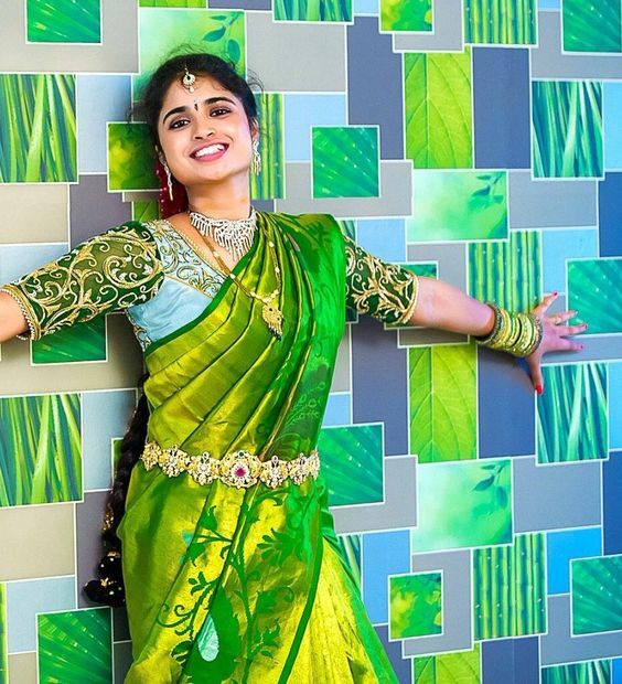 Parrot green Kanjeevaram saree | South Indian wedding saree trends featured by top US and Indian fashion blog, Dreaming Loud: image of a green saree