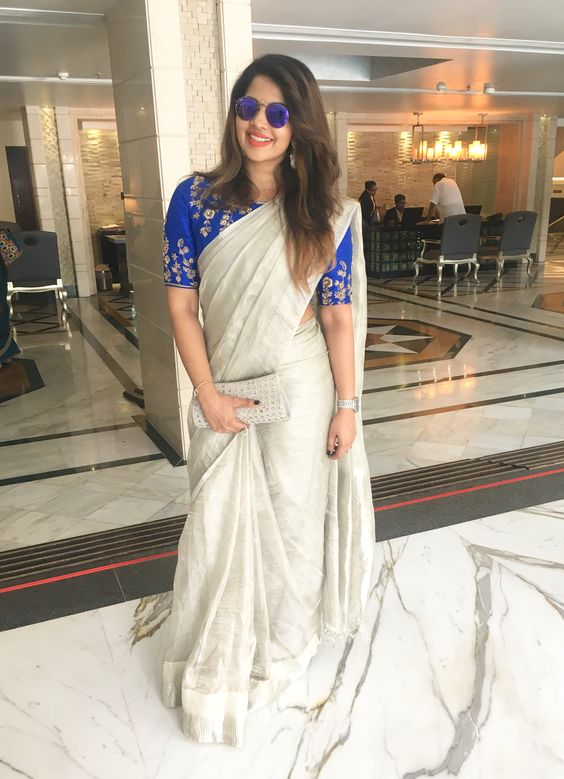 Silver tissue saree wedding guest saree trends | South Indian wedding saree trends featured by top US and Indian fashion blog, Dreaming Loud: image of a metallic silver Saree