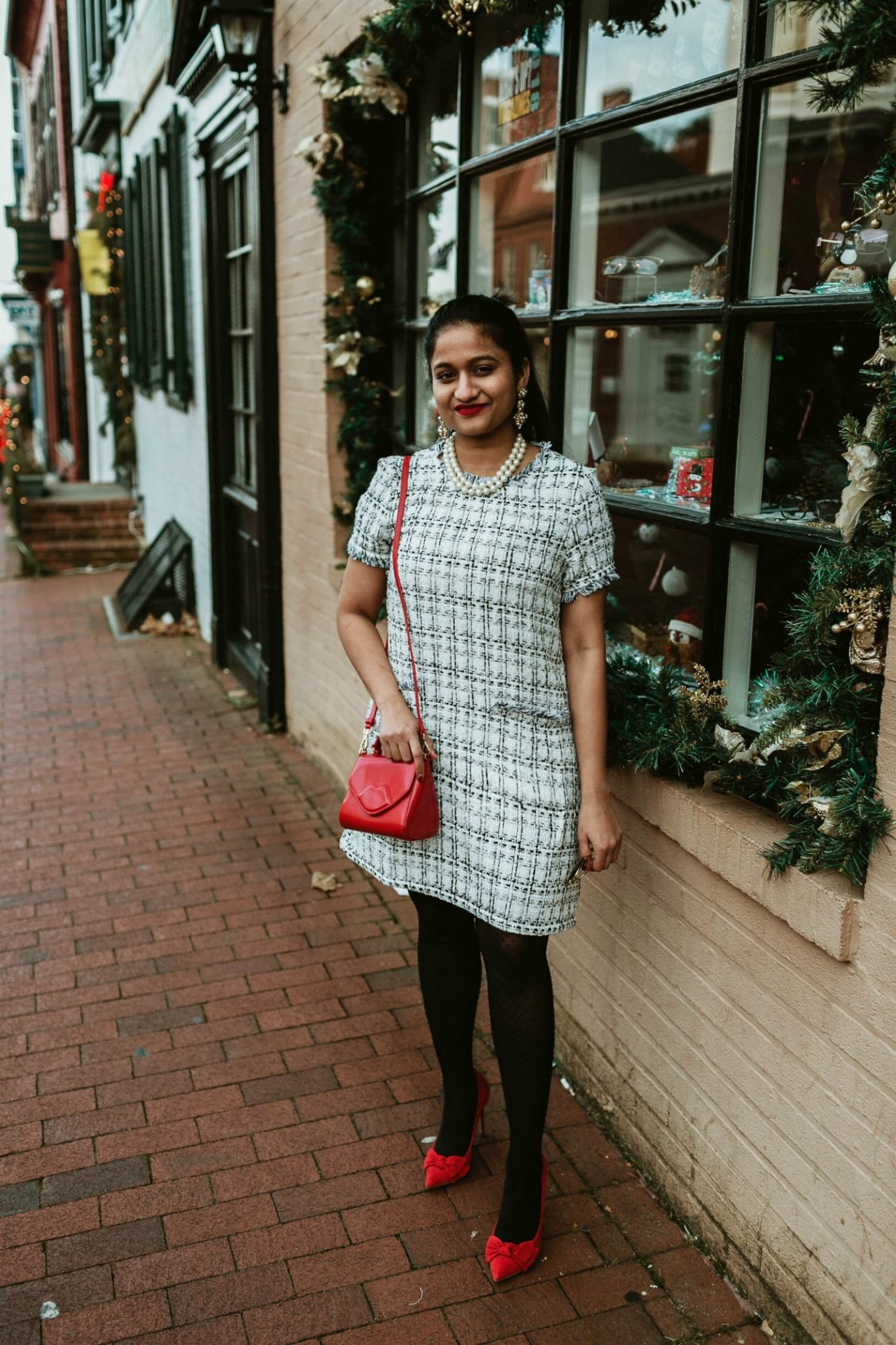 how to wear or style tweed dresses | Thoughts on Defining Priorities featured by top US modest fashion blog, Dreaming Loud: image of a woman wearing a SheIn tweed dress, Carolee pearl necklace, red bow pumps
