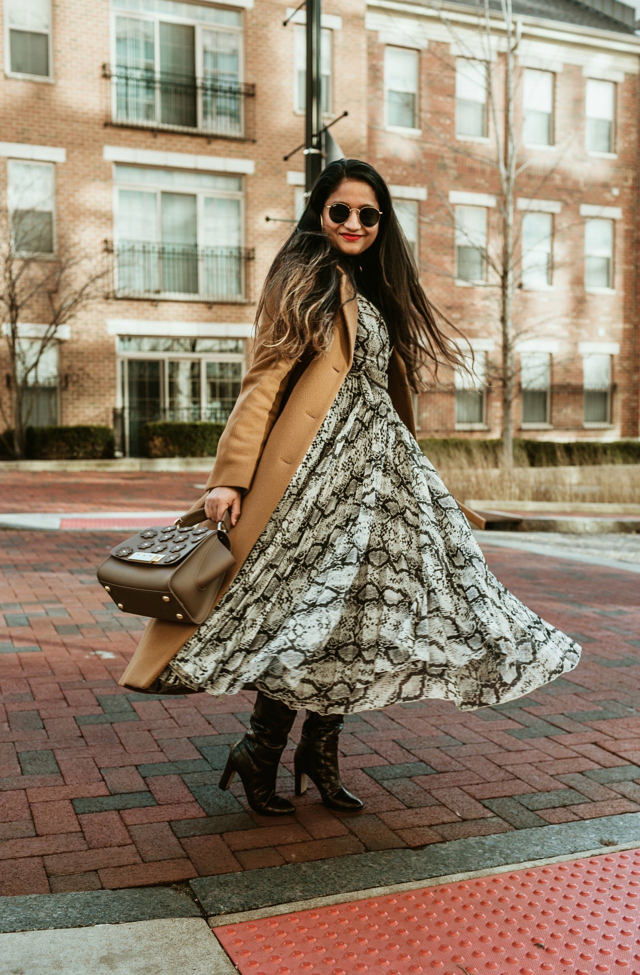 Snakeskin Print Pieces featured by top US modest fashion blog, Dreaming Loud: image of a woman wearing a snakeskin print H&M dress, Madewell turtleneck, & other stories would belted coat, Forever21 over the knee boots, Zac Posen bag, Madewell hoop earrings, and round Ray Ban sunglasses