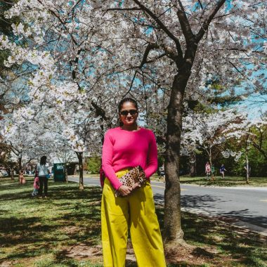 Tips to style neon yellow pants featured by top US modest fashion blog, Dreaming Loud: image of a woman wearing a J Crew pink sweater, ASOS wide leg neon yellow pants, ALDO snake print stilettos, ALDO snakeskin stilettos, Clare V leopard clutch, Madewell hoop earrings and Urban Outfitters sunglasses.
