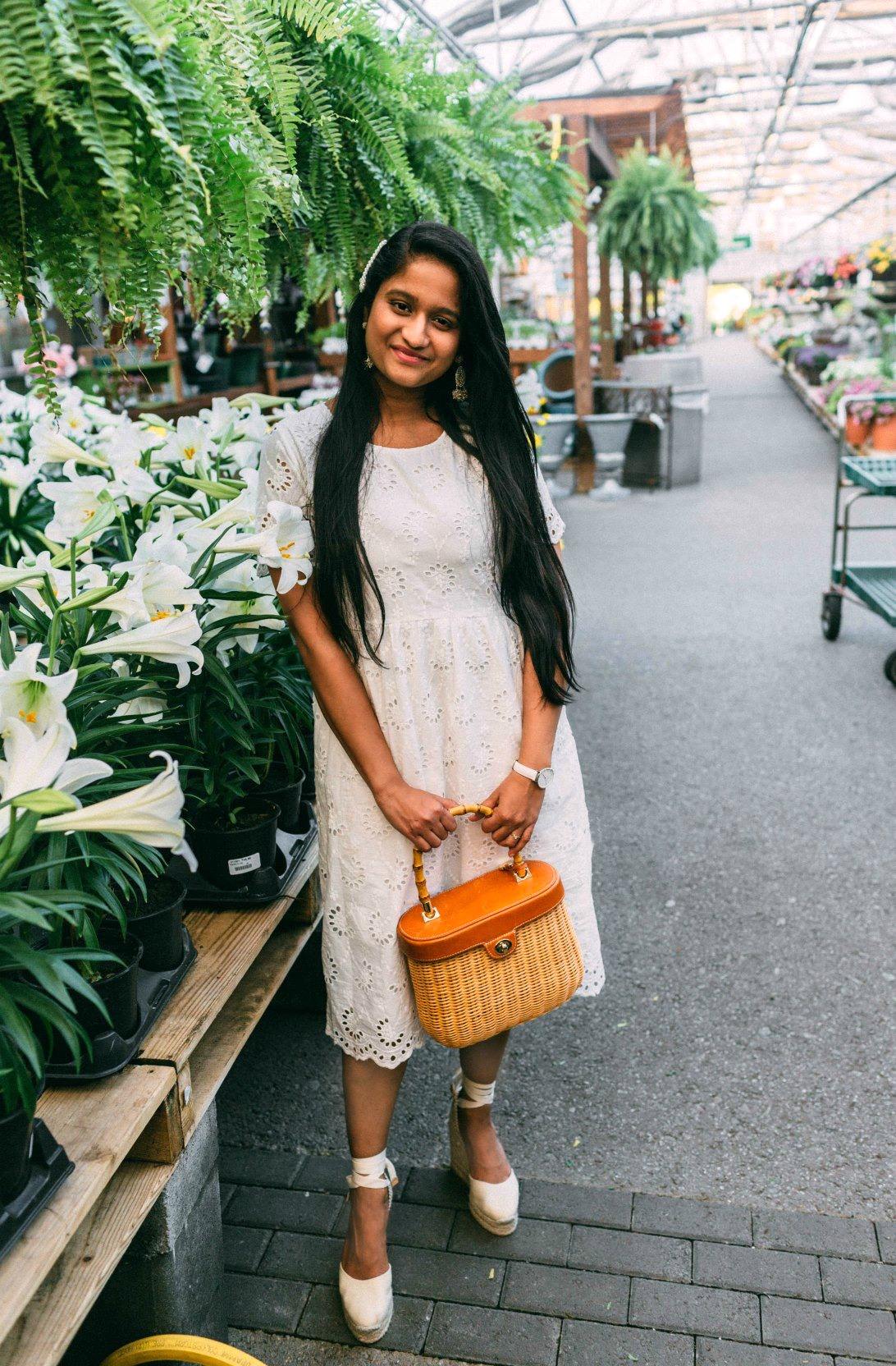 Modest White Dress styled for Spring by top US modest fashion blog, Dreaming Loud: image of a woman wearing a Merry Modest Apparel white dress, Castaner wedge sandals, Wicker bag, Daniel Wellington watch and pearl hair pins
