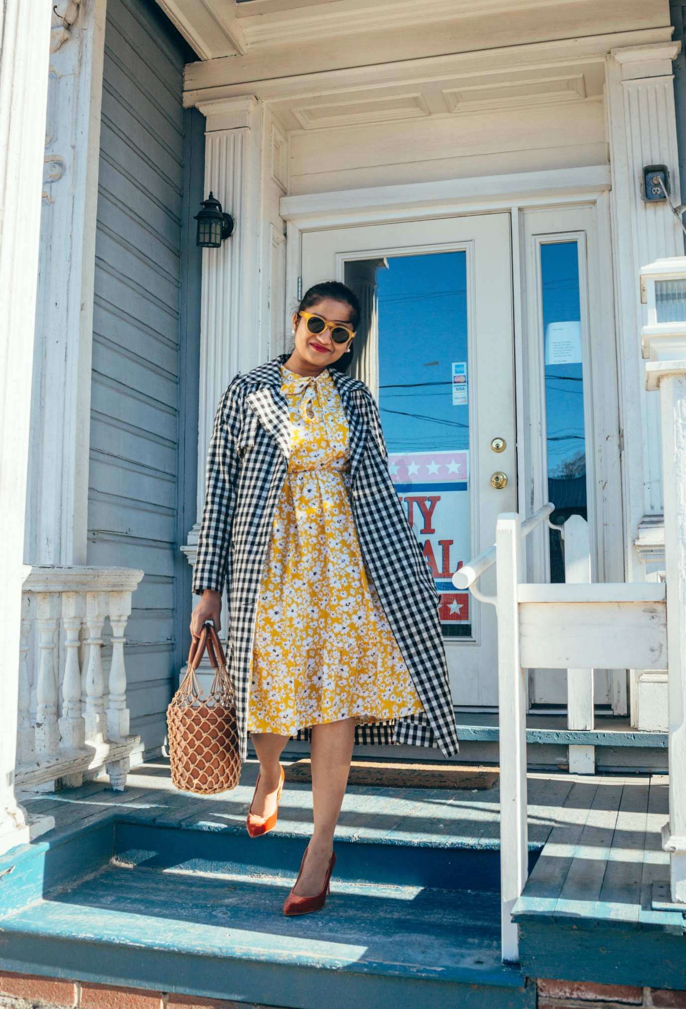 Wearing Shein Tie Neck Daisy Tea Dress | Modest spring dresses featured by top US modest fashion blog, Dreaming Loud: image of a woman wearing a SheIn floral dress, SheIn gingham coat, Sam Edelman velvet pumps, STAUD bag and Amazon circle sunglasses
