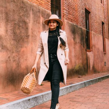 All black outfit for Spring Summer featured by top US modest fashion blog, Dreaming Loud: image of a woman wearing a BB Dakota black lace top, Madewell black skinny jeans, Brooks Brothers trench coat, MANEBI raffia espadrilles, and STAUD bag