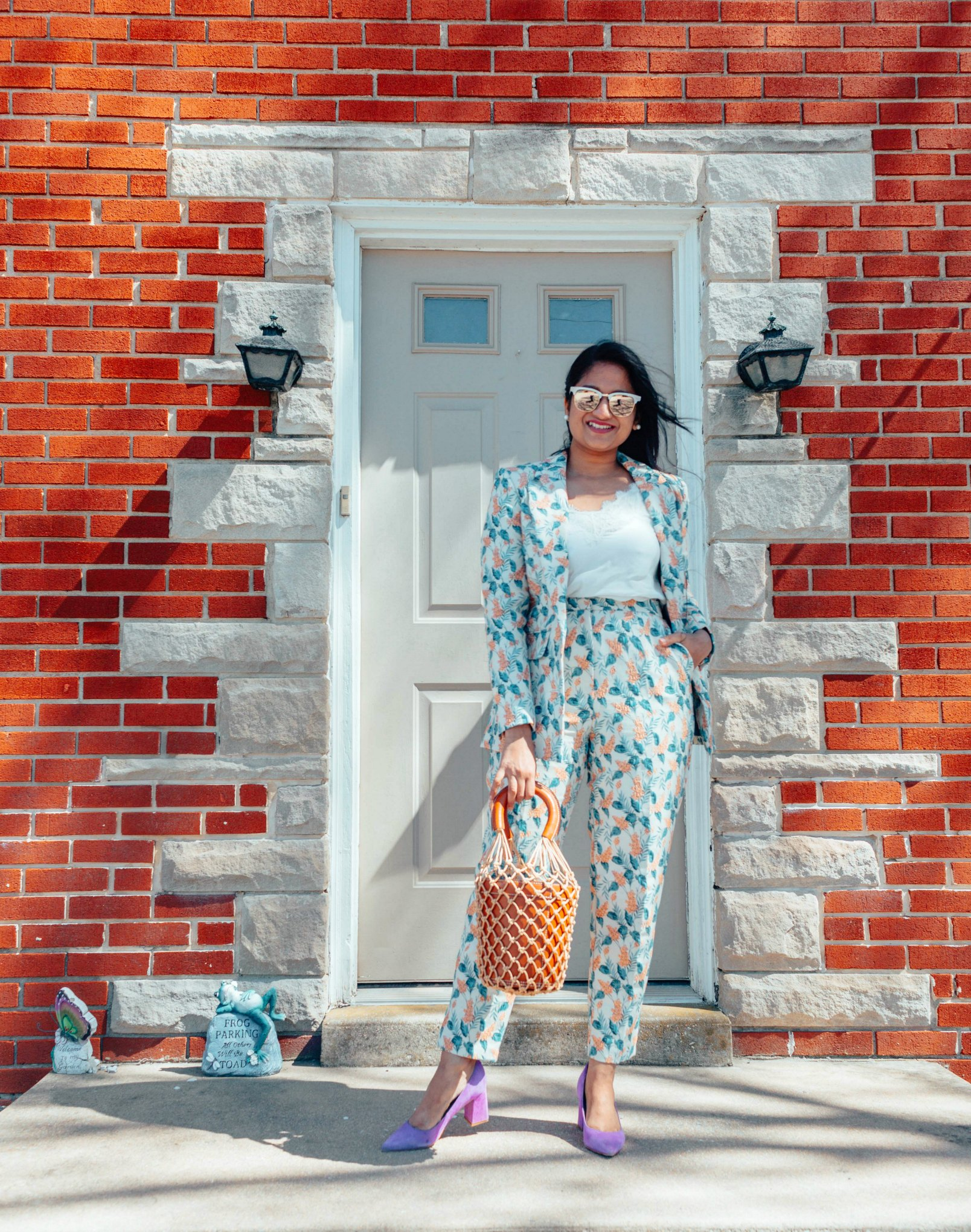 How to wear jacquard wisteria floral blazer two-piece set | Modest Spring outfits featured by top US fashion blog, Dreaming Loud: image of a woman wearing an ASOS floral pant suit, Abercrombie and Fitch lace cami, STAUD bag, Marc Fisher pumps and Ray ban aviator sunglasses