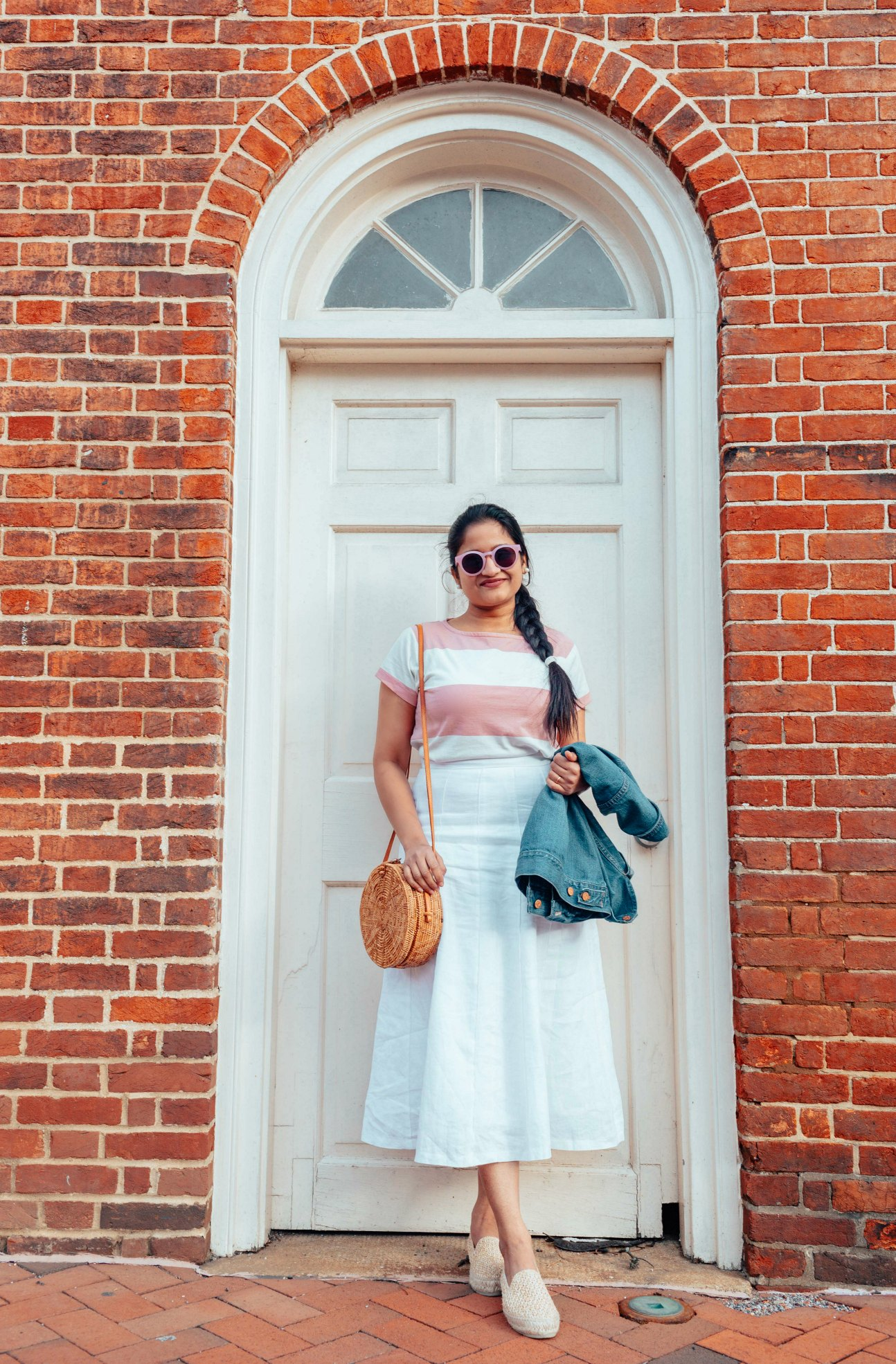 Modest Spring outfits featured by top US fashion blog, Dreaming Loud: image of a woman wearing a BP striped tee, Boden ivory midi skirt, MANEBI raffia espadrilles, Madewell denim jacket and round rattan shoulder bag