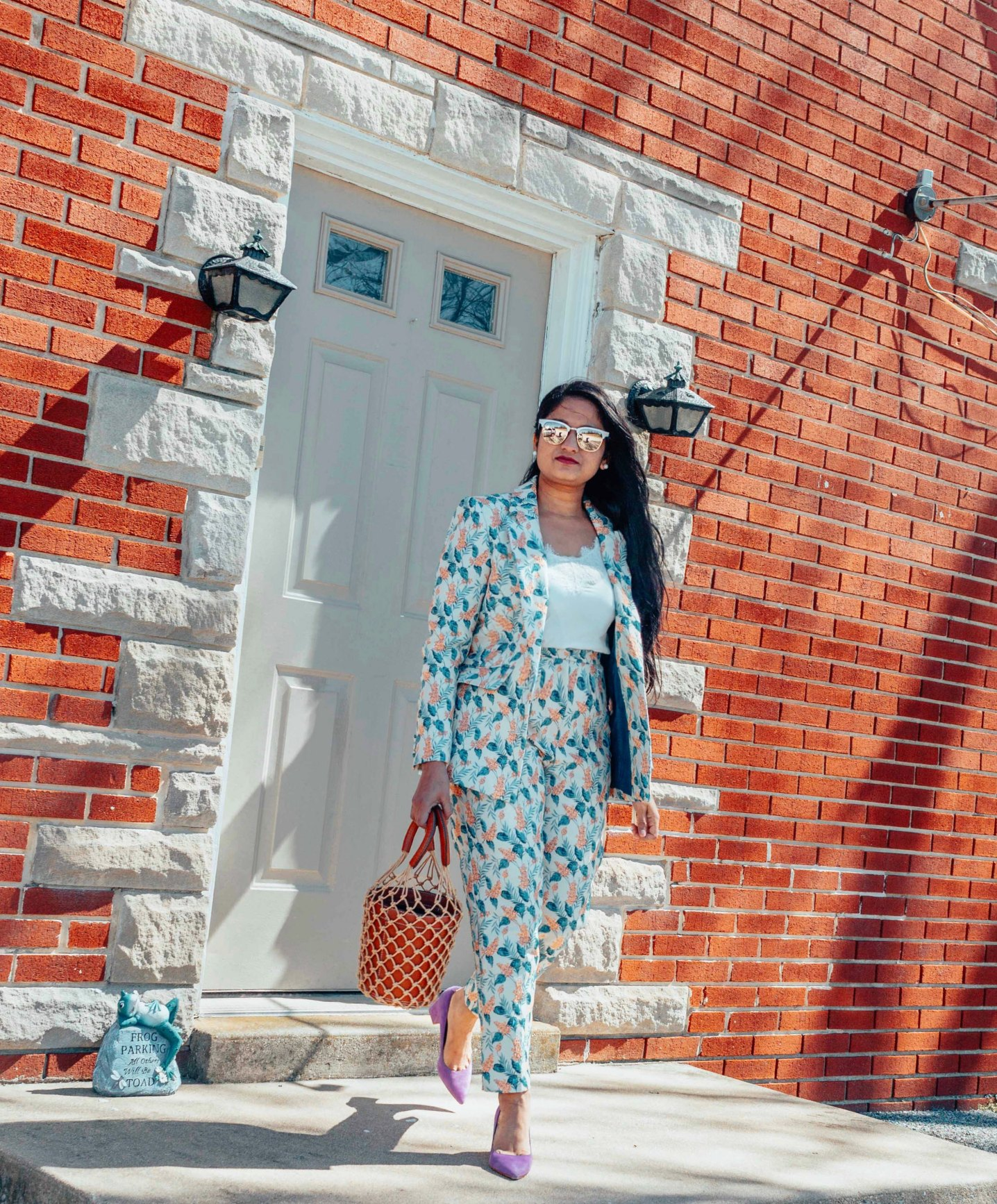 Wearing Asos tailored jacquard wisteria floral blazer two-piece | Modest Spring outfits featured by top US fashion blog, Dreaming Loud: image of a woman wearing an ASOS floral pant suit, Abercrombie and Fitch lace cami, STAUD bag, Marc Fisher pumps and Ray ban aviator sunglasses