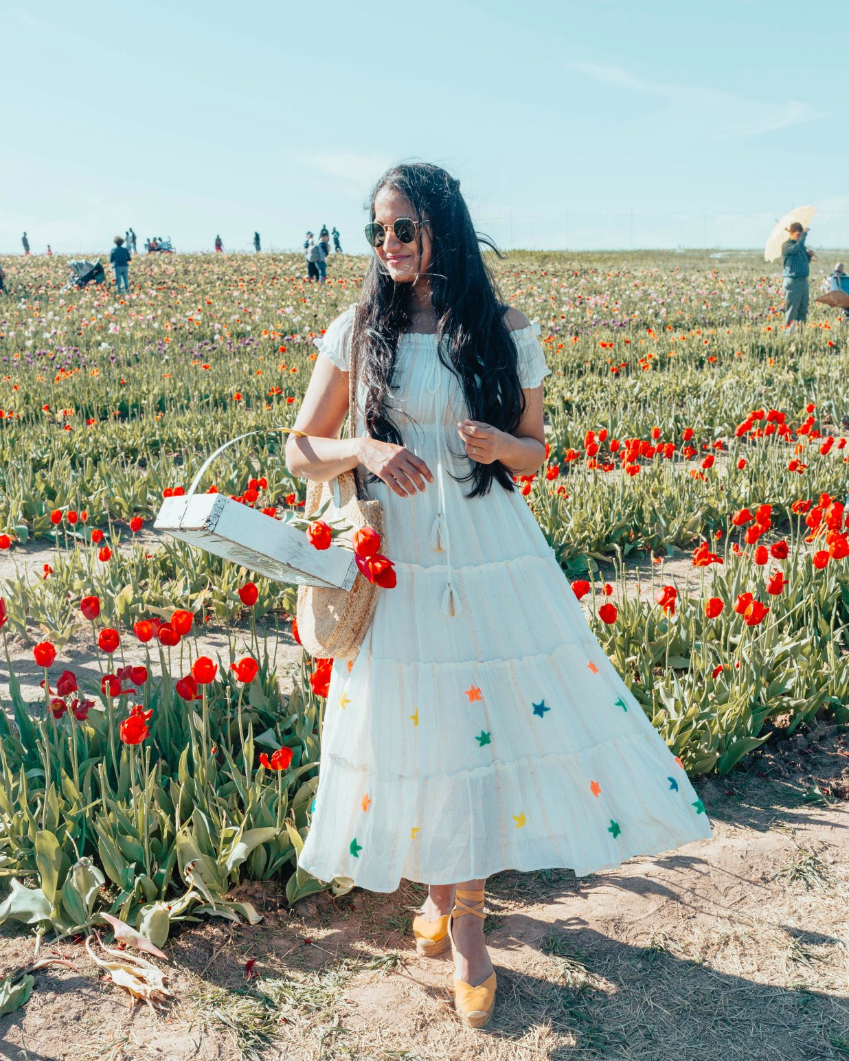 White off the shoulder dress featured by top US modest fashion blog, Dreaming Loud: image of a woman wearing a Red Dress Boutique white off the shoulder dress, Castaner wedges, Red Dress Boutique round bag, BaubleBar drop yellow statement earrings