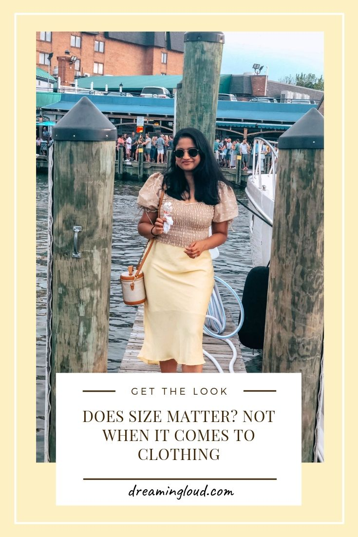 Top US modest fashion blog, Dreaming Loud, features their thoughts on Clothing Size: image of a woman wearing a Leith stain skirt, a polka dot smocked top, Ann Taylor polka dot pumps, Paravel crossbody bag, and Madewell hoop earrings